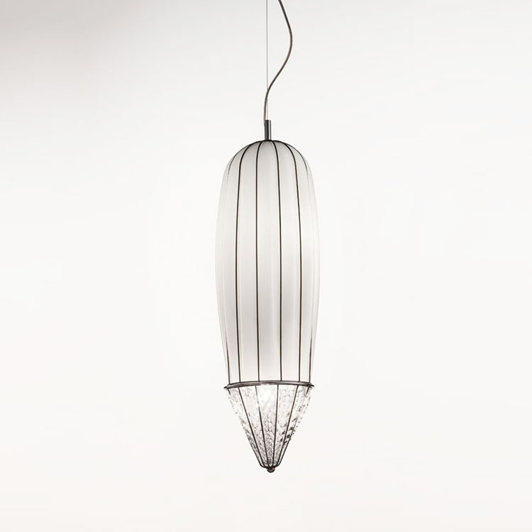 Pencil Pendant Light - The Pencil Pendant Light is, as the name suggests, pencil shaped with a smooth cylinder going towards a point at the end. This pendant light would look elegant in most open spaces and would look perfect hanging in the middle of a spiral staircase. This piece is hand made blown glass with suspension using the techniques of the old Murano glass masters. This light comes in three finishes: Smooth Milk White, Amber Stacked and Smoke Strike 250V Input. 4X E14 max 40W ~ IP20 Bulbs  | Matter of Stuff