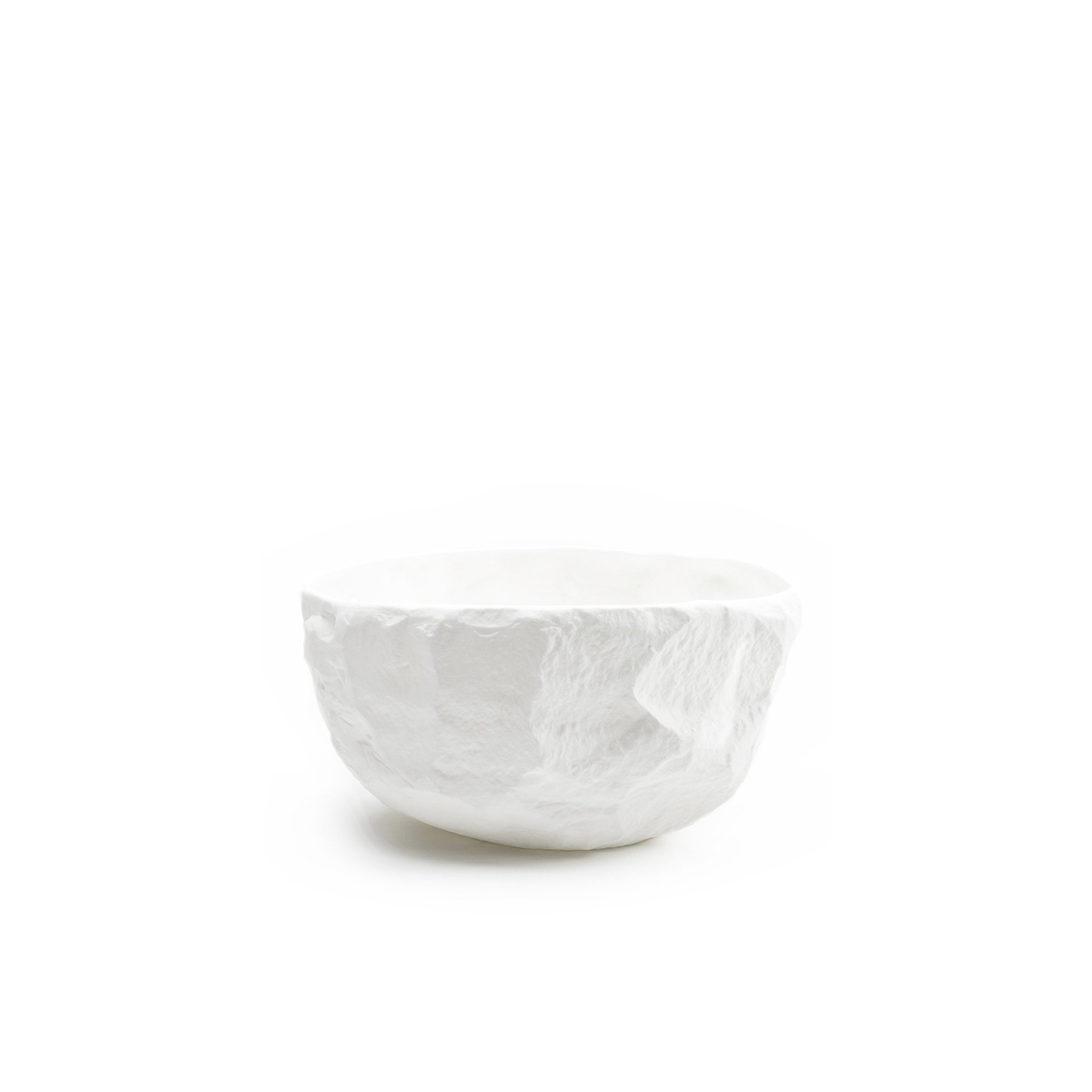Crockery White Large Deep Bowl - A collection of fine bone china tableware slip-cast from plaster models carved by hand, with glazed interior for functionality and raw exterior reflecting the modest surface texture of the plaster original. The process of slip-casting begins with the creation of a three-dimensional model of the design known as a master by a professional model-maker, from which the production mould is cast. Crockery bypasses this process by placing the responsibility of both designer and model-maker in the hands of Max Lamb. Using the tools of a stone mason Max chips and carves a solid block of plaster to make a series of tableware, the design of each formed quite simply out of their own making.  | Matter of Stuff