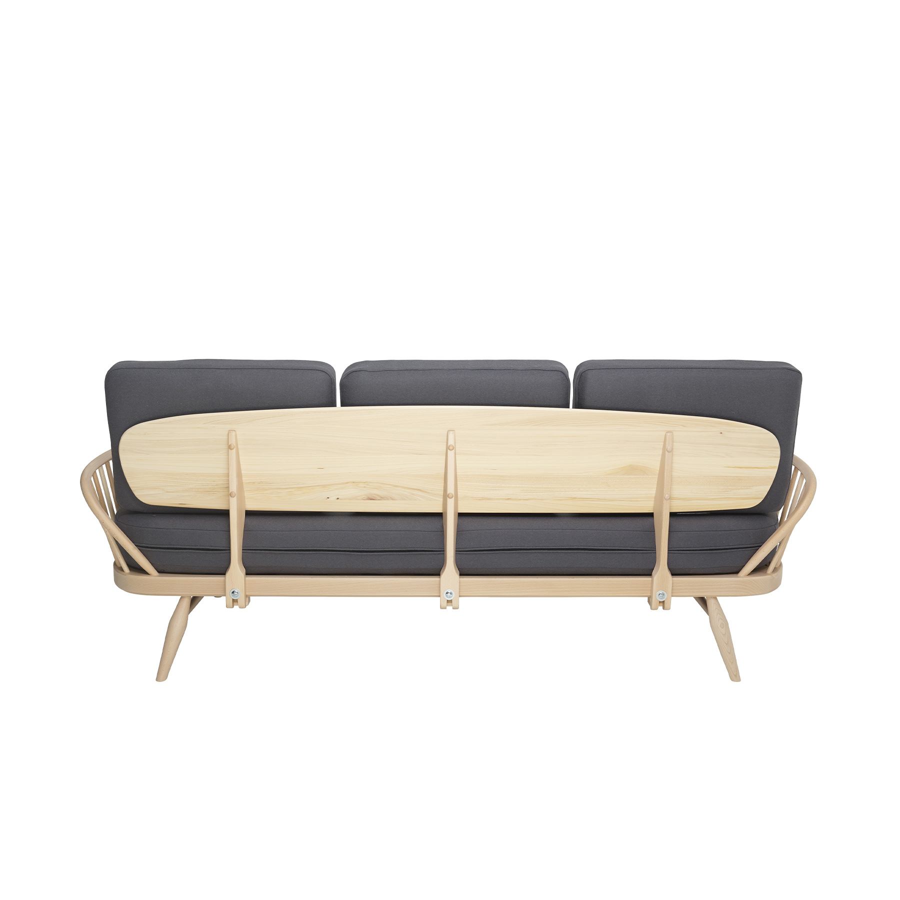 Originals Studio Couch - <p>The Ercol Originals are pieces of timeless and classic design that never date or show their age. It is furniture that is as relevant and as functional now as it was when it was created in the 1950s and 1960s. This furniture was designed by ercol's founder, Lucian Ercolani, who drew for his inspiration on the time proven local design and craft in the Chiltern Hills around where he lived and built his first factory in 1920 in High Wycombe. Using the strength of beech and the beauty of elm he carried this definition on into a huge variety of dining, kitchen, and school chairs and then extended the idiom into the low easy chair range epitomised by the 206 armchair and the studio couch. The beauty of the colour and the grain of the elm took Lucian on to use elm for the tables and cabinets of the Originals and the following Windsor range. This versatile couch features an attractive steam bent frame consisting of tapered spindles and arched arm rests. The back rest is formed from a large board of Ash. Designed to function as a large couch and as an occasional single bed for guests, this distinctive sofa is both eye catching and wonderfully flexible. The seat and back cushions are made of foam and offer a comfortable sit.  Rubberised webbing at the base of the settee provides extra support.  The couch will be covered in your choice from a range of ercol fabrics, to suit the style and decor of your home. The studio couch frame will be finished in your choice of a selection of lacquer finishes or in a choice of our painted colour finishes, which protects the timber as well as fitting in with your style and decor.</p>