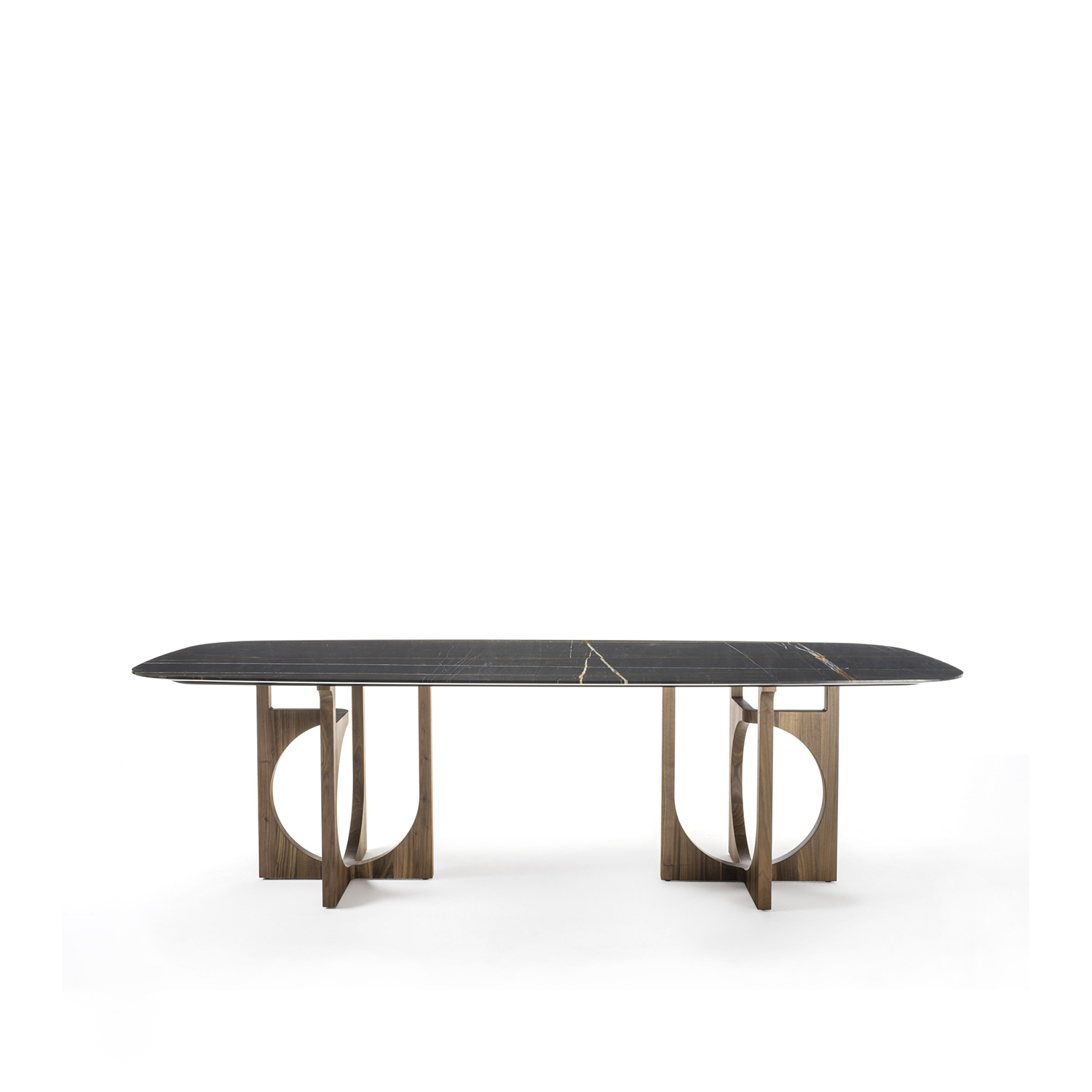 Vuoto Table with Double Base - Vuoto table is a combination of material and space that creates a sophisticated three dimensional structure. The asymmetric base in solid wood looks different from different viewing angles. The table can have different developments depending on the use of one or two bases, giving the possibility to have tops of different shapes and sizes. Precious wood essences are combined with marble and glass in order to make Vuoto even more valuable. Also available with just one base in a short variant. | Matter of Stuff