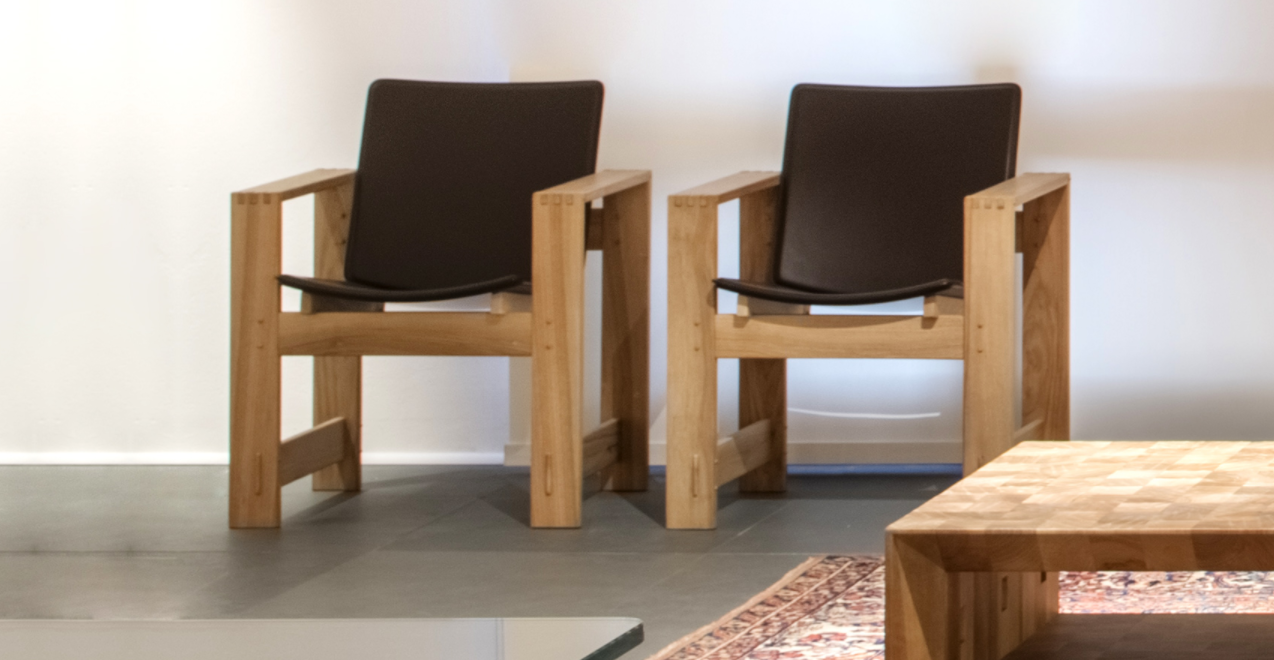 """S.Marco Armchair - <p>San Marco is an armchair with solid wood structure assembled by the interlocking technique. The seat and backrest are upholstered in leather.<br /> All the surfaces are sanded. The entire manufacturing and finishing process is carried out manually in our workshop. The wood used for this piece is Juglans Regia – common Italian walnut; not dried but """"raw"""". This wood belongs to the Latin tradition of furniture-making and features an extremely compact fibre which can, however, be worked without too much difficulty; it is therefore highly suitable for household items. Over time the wood hardens and becomes extremely resistant, and oxidises slightly to take on a progressively warmer amber colour. Customise and made with European cherry, Slavonian oak, maple.</p>  