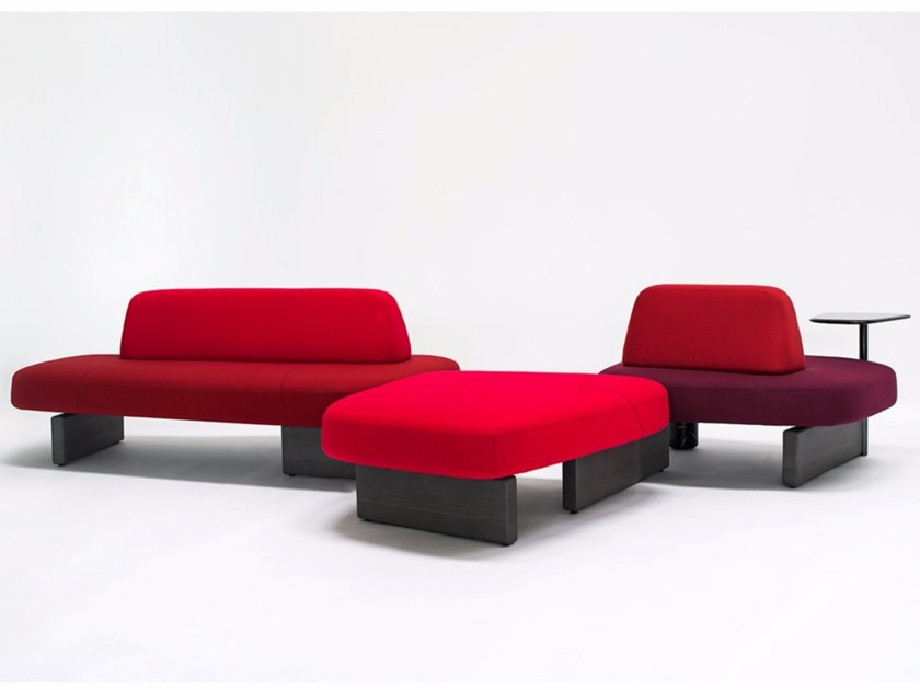 Ischia Modular Sofa - In the beginning, there were rocks, shaped bythe wind and the waters, veined stones, perfectly overlaid or slotted together by nature. Then, when organic shapes inspired artistic forms, we saw monoliths such as those of Barbara Hepworth and abstract paintings from Serge Poliakoff. Descended from this same line is the new design by Pearson Lloyd, a modular system influenced by natural shapes and artistic allusions, destined for collective settings. Ischia comprises a number of freely-combinable individual components: the seats can be single or double, and come with or without a backrest. The system also offers the possibility of adding a table or a woven cane screen, to keep any given area separate and hidden away. The components have an essential feel, with soft shapes and oblique lines, balanced out by the strong finishes of the wood or marble bases that connect them up.  This item is available in various sizes and combinations. Please enquire for more information and prices. | Matter of Stuff