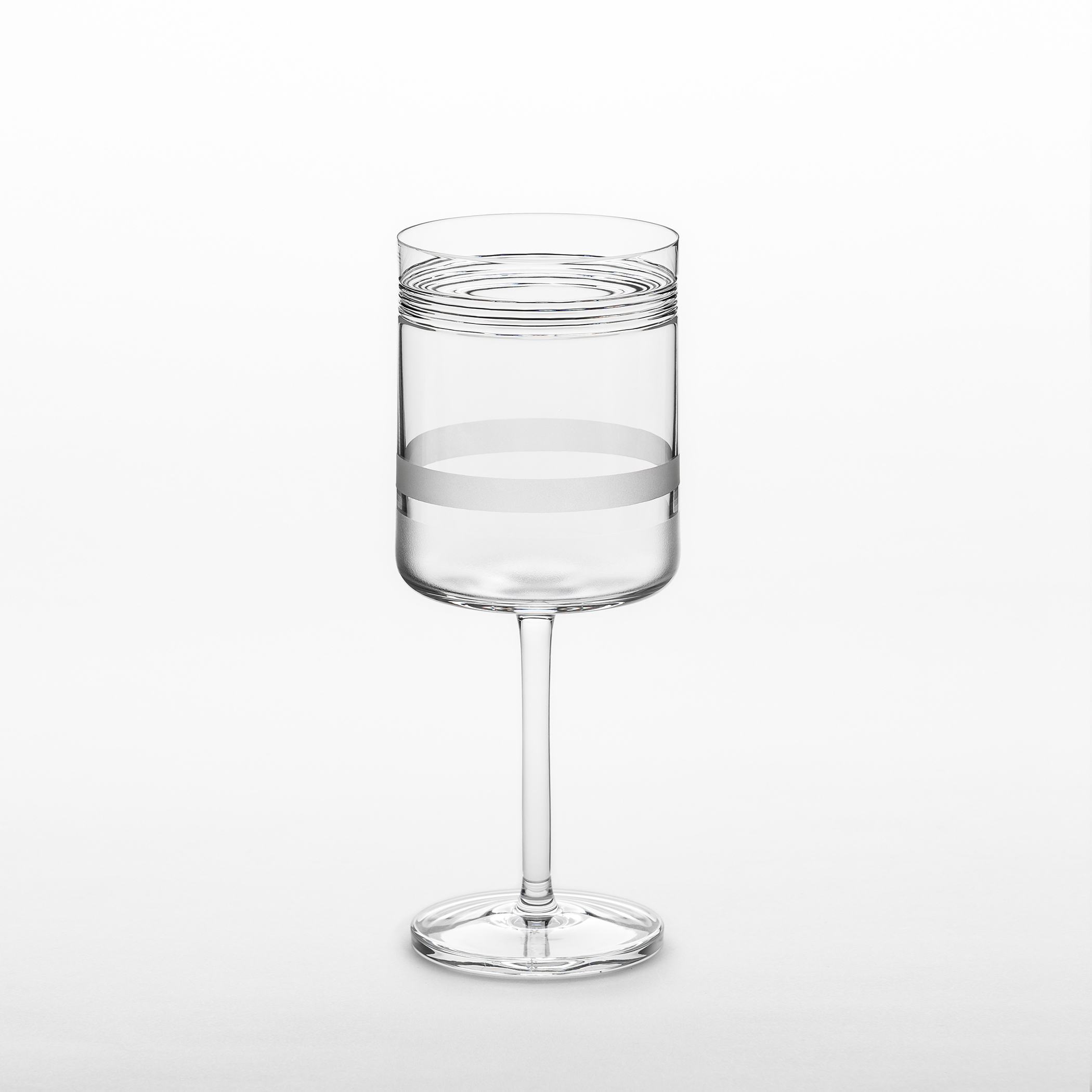 """Element Red Wine Glasses - Set of 2 - A rich assemblage of graphic markings defines the """"ELEMENTS"""" series of lead crystal. Cuts and textures of varying depth and intensity are employed across glasses to create a landscape of layered pattern that is fresh and seductive; a whole new take on the decoration of cut crystal. Sold as a set of 2  