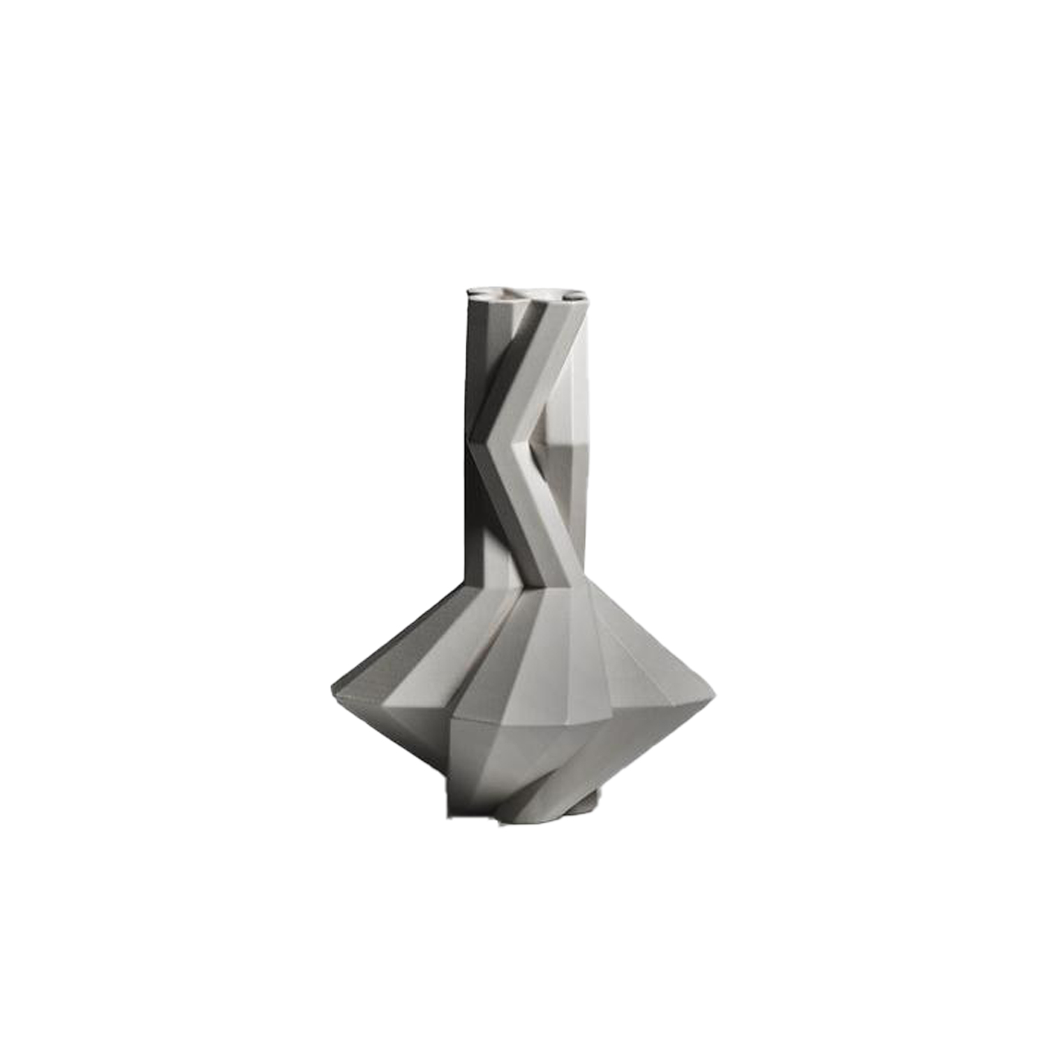 Fortress Spire Grey - Designer Lara Bohinc explores the marriage of ancient and futuristic form in the new Fortress Vase range, which has created a more complex geometric and modern structure from the original inspiration of the octagonal towers at the Diocletian Palace in Croatia. The resulting hexagonal blocks interlock and embrace to allow the play of light and shade on the many surfaces and angles. There are four Fortress shapes: the larger Column and Castle (45cm height), the Pillar (30cm height) and the Tower vase (37cm height). These are hand made from ceramic in a small Italian artisanal workshop and come in three finishes: dark gold, bronze and speckled white.  | Matter of Stuff