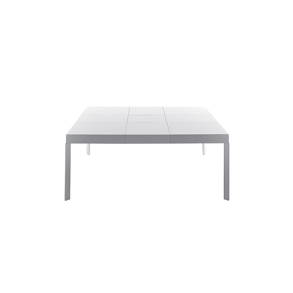 Unisono Extensible Table - Square extending table in both directions with aluminium runners. Rigorous but original, the taut lines makes Unisono a classic table, but owner of unique and particular elegance. The sophisticated technology hidden inside easily extends the top until 1,80 meters long.  | Matter of Stuff