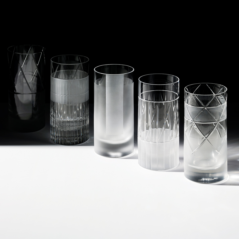 """Element High Glasses - Set of 6 - A rich assemblage of graphic markings defines the """"ELEMENTS"""" series of lead crystal. Cuts and textures of varying depth and intensity are employed across glasses to create a landscape of layered pattern that is fresh and seductive; a whole new take on the decoration of cut crystal. Sold as a set of 6 high glasses.  