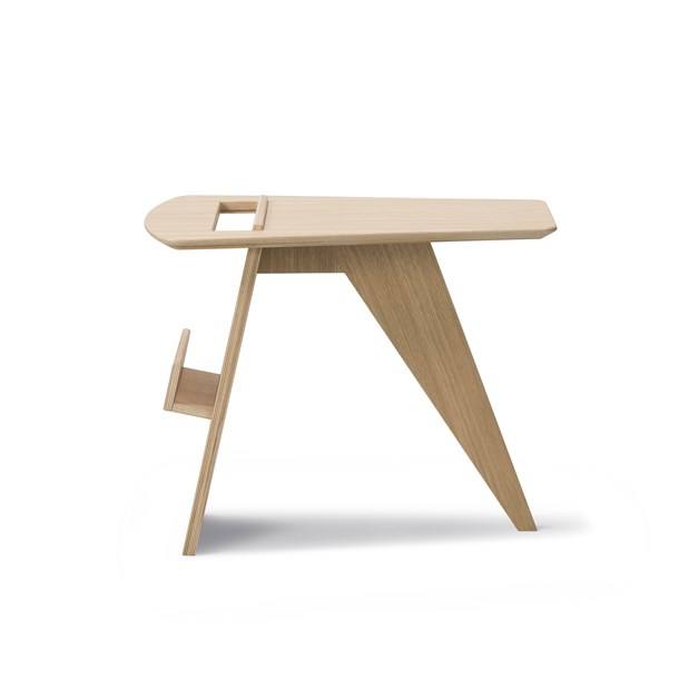 Magazine Table - Originally designed in 1949, The Magazine Table reflects Risom's idea that key to good design is comfort, the warmth of wood with a graceful style. Available in lacquered or black lacquered oak plywood, the mix of soft lines and carefully crafted cut-outs and curves makes this the perfect place for any reading material - in any number of contemporary settings. From private homes to reception areas, lobbies or hotel rooms  Although many of our sofas and lounge chairs comprise our most celebrated designs, we have smaller pieces that are distinctive, well-crafted, modern originals in their own right. Pieces that add a touch of personality and practicality. A sense of cosiness. As punctuations to a style statement. Or just the pieces you were looking for to create a sense of completeness. Because when it comes to interior décor, sometimes the smallest detail can make the biggest difference.   Matter of Stuff