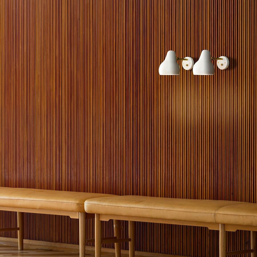 VL38 Wall Light - The fixture emits downward directed light. The angle of the shade can be adjusted to optimize light distribution. The shade is painted white on the inside to ensure a soft comfortable light. | Matter of Stuff