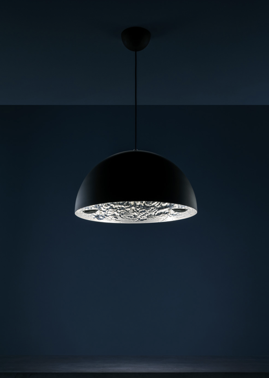 Stchu-Moon 02 Pendant Lamp - Stchu-Moon separates the light source from the lighting object, which takes on its own aesthetic quality as a result. The light is refracted off deliberately irregular surfaces, which multiplies their quantity, making the entire object a glowing light. | Matter of Stuff