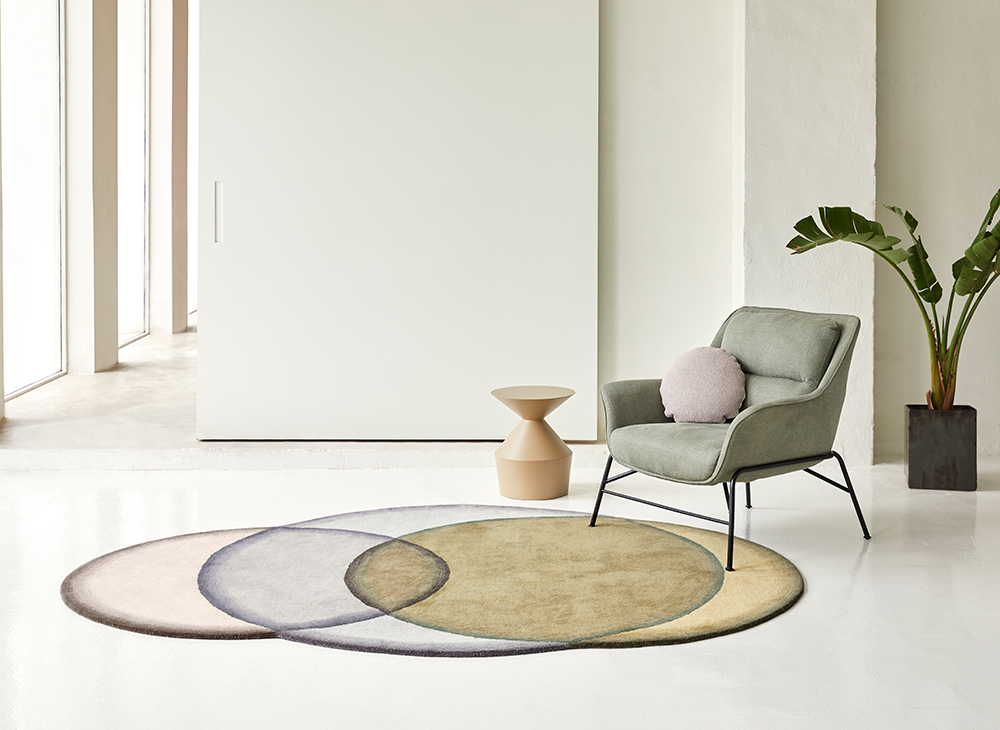 """Crystal Rug - Originally called """"Glass rugs"""" this collection resembles a stained glass window with overlapping colours all conforming to a circular shape. The manufacturing technique is hand tufted and due to the handmade nature of the GAN product, slight variations in size, colour, finish are normal.  