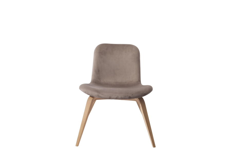 Goose Lounge Chair - The idea of the Goose Lounge Chair, based on the Langue Chair, was to create a highly comfortable lounge chair that is small enough to fit into any kind of interior space. Its beautiful fabric and leather make it suitable for a hotel suite or complimenting a sofa in a private home.  The soft seat is contrasted by two pointing oak veneer legs crossing beneath the seat. The legs are available in natural oak, dark stained and black. The wide range of upholstery options include our Vintage Leathers, Velvet, Sheep skin and various types of Kvadrat materials to personalise the chair. | Matter of Stuff