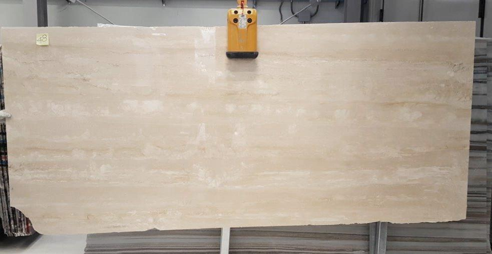 """Navona Travertine - <span class=""""label-det"""">Travertino Navona, an Italian travertine with a light beige color and characteristic light veins with small and rather closed pores. Colour variations always occur to some extent, although limited. </span> <ul class=""""dati-generali"""">  <li class=""""field-carico_di_rottura_a_compressione""""><span class=""""label-det"""">Compression tensile strength</span><span class=""""value-det"""">1102 Kg/cm²</span></li>  <li class=""""field-carico_di_rottura_unitario_a_flessione""""><span class=""""label-det"""">Unitary modulus of bending tensile strength</span><span class=""""value-det"""">137 Kg/cm²</span></li>  <li class=""""field-coefficiente_dilatazione_termica""""><span class=""""label-det"""">Heat expansion coefficient</span><span class=""""value-det"""">0,0053 mm./m. oC</span></li>  <li class=""""field-peso_per_unita_di_volume""""><span class=""""label-det"""">Mass by unit of volume</span><span class=""""value-det"""">2467 Kg/m³</span></li> </ul> 