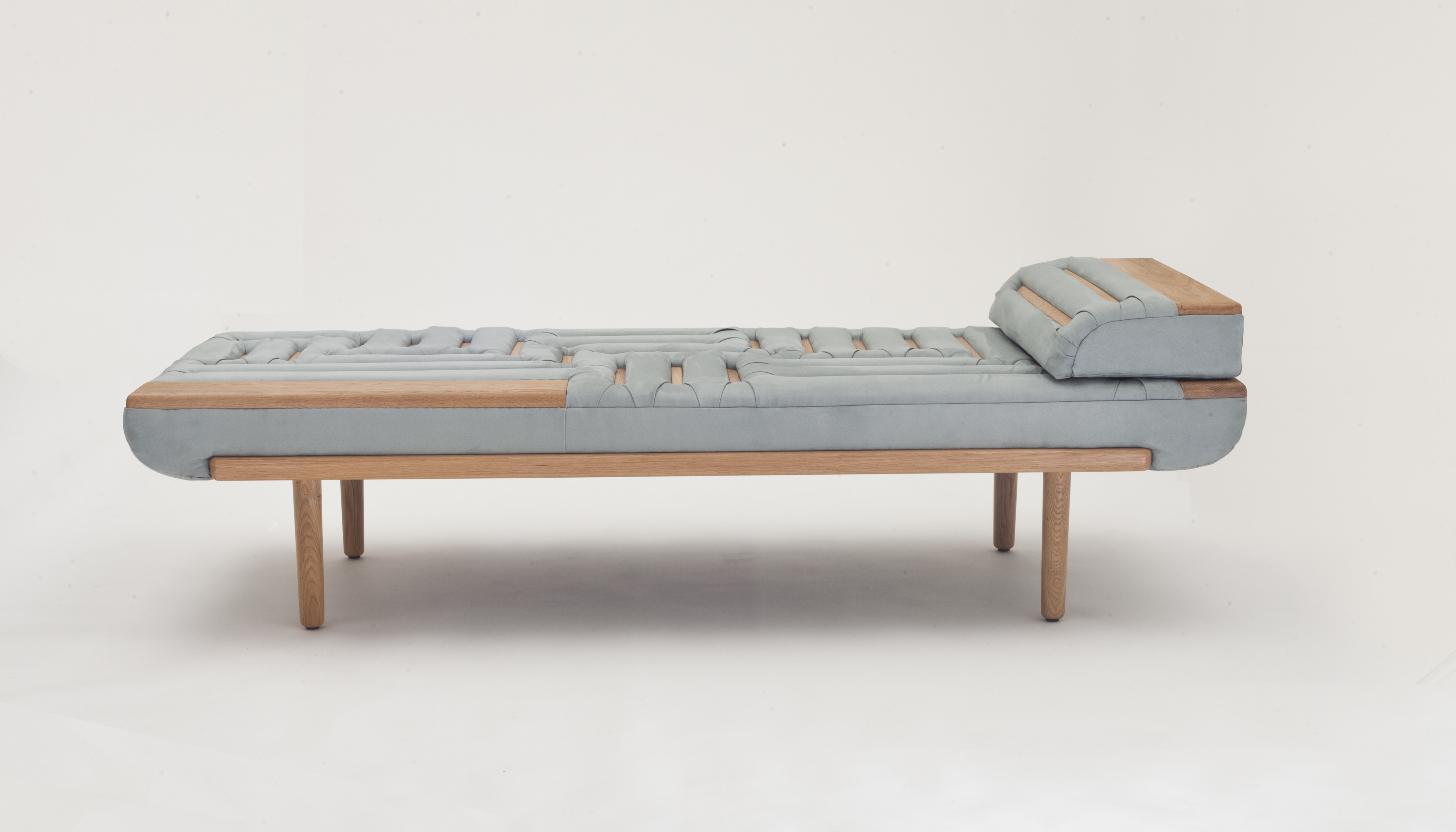 Lignes de Capiton Day Bed - <p>Lignes de Capiton day bed presents an innovative use of the traditional upholstery technique of capitonnage – button sofa. The wood beams function both as an alternative to the buttons that pin-down the cushioned fabric and as means of giving a shape and a pattern to an otherwise blank surface. This piece calls into attention the peculiar nature of wood beams as an element that transcends, throughout the history of furniture, the entire range between function and decoration.</p>  | Matter of Stuff