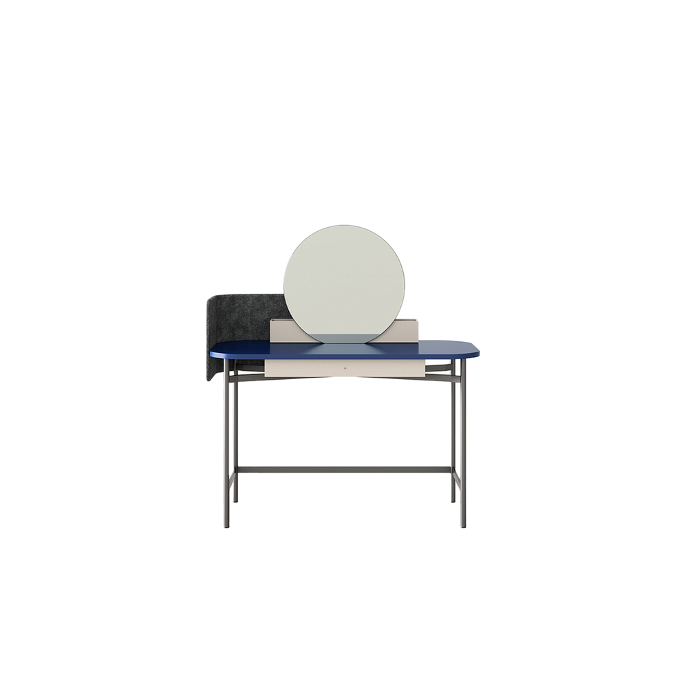 Ninfea Mirror Desk - Ninfea is a desk with simple, elegant lines. A top with soft, rounded shapes sits on slender metal legs. The privacy screen, in fabric or extra leather, doubles as a little noticeboard for posting notes and documents on using magnets attracted to its metal inner. The desk, which has a handy undermounted drawer, is ideal for recreating a reading nook in the bedroom, has a dressing table-esque setup with its wooden caddy and circular mirror.  Top with drawer and caddies come in lacquered or veneered chipboard panel. Base and knob -painted metal with a bronze finish.   Mixed combinations of finishes are available for individual prices.       Matter of Stuff