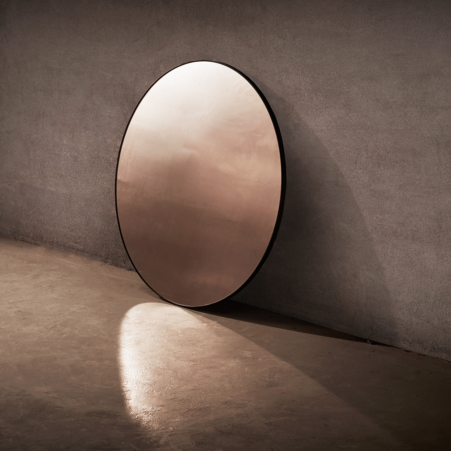Port Round Mirror - The Port Round Mirror is a minimal, circular wall mirror in blackened steel. Ideal for adding a modern touch to kitchens and living rooms. It has been hand crafted and is made to order in the North of England. Custom sizes and finishes are available. Please enquire for more information.  | Matter of Stuff