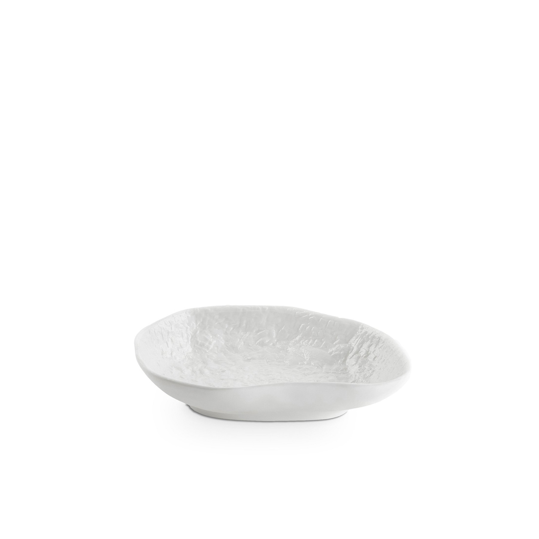 Crockery White Small Platter - A collection of fine bone china tableware slip-cast from plaster models carved by hand, with glazed interior for functionality and raw exterior reflecting the modest surface texture of the plaster original. The process of slip-casting begins with the creation of a three-dimensional model of the design known as a master by a professional model-maker, from which the production mould is cast. Crockery bypasses this process by placing the responsibility of both designer and model-maker in the hands of Max Lamb. Using the tools of a stone mason Max chips and carves a solid block of plaster to make a series of tableware, the design of each formed quite simply out of their own making.  | Matter of Stuff