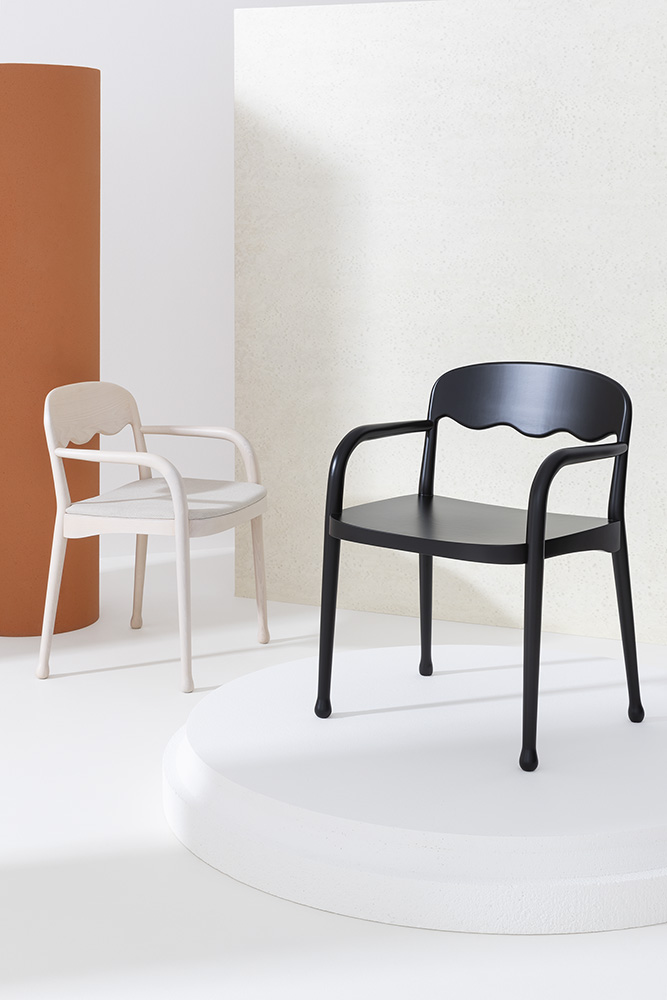 Frisee Upholstered Armchair - The Frisee Upholstered Armchair is an ergonomic and sleek armchair that fits in almost anywhere. As is noticeable in the Frisée collection it has the wavy backrest and the slightly slanted legs with felt pads. This armchair has a frame in either Ashwood or Beechwood and can be lacquered and an upholstered seat that can be fabric, leather or your chosen fabric. Please enquire for more information.  | Matter of Stuff