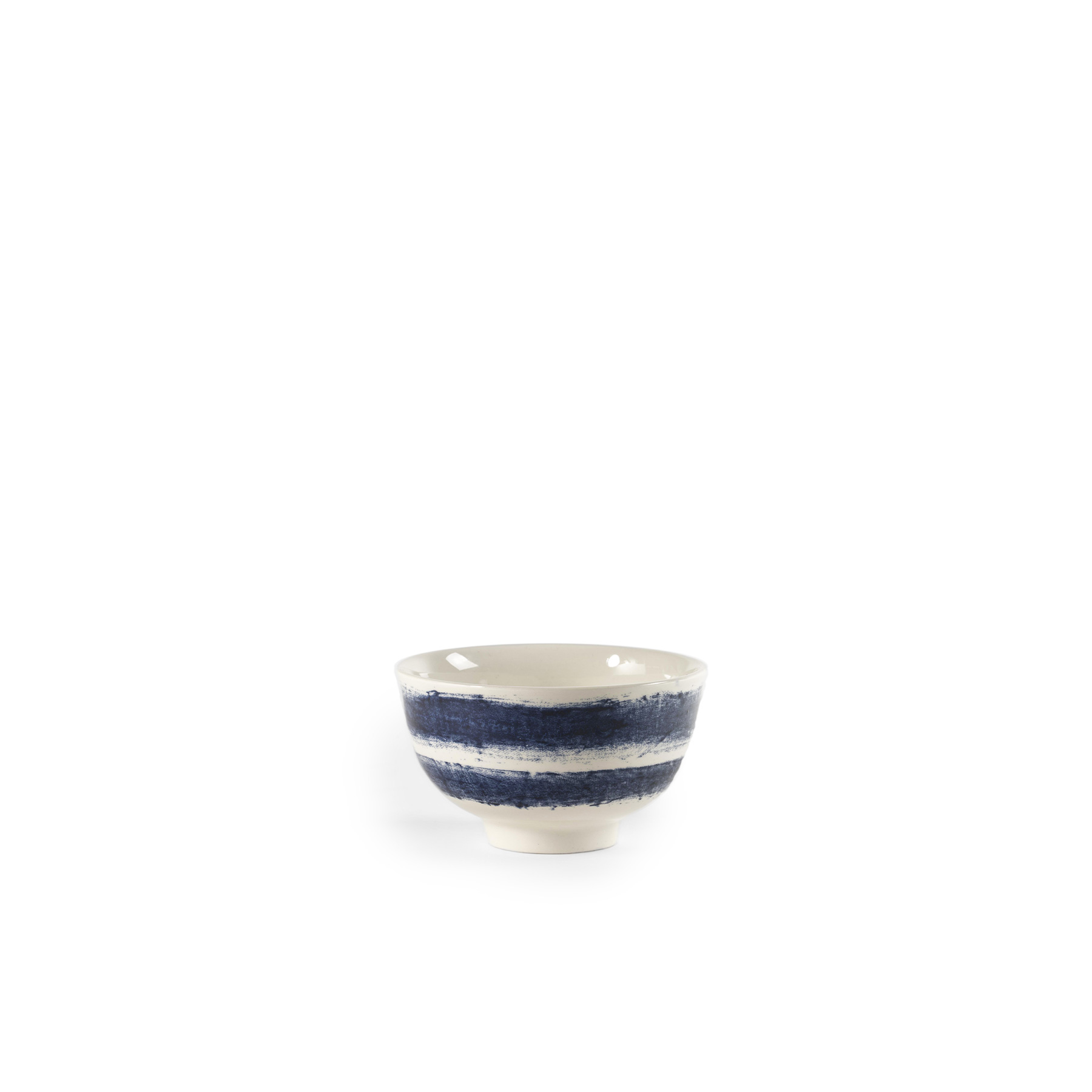 Indigo Rain Handleless Cup - Faye Toogood's addition to her range of ceramic designs for 1882 Ltd. puts a fresh spin on the forms and traditions of English creamware. Indigo Rain reinterprets the homely familiarity of blue-and-white striped crockery in a new design informed by the spirit of serendipitous discovery. Representing a streamlined take on our ceramic heritage, the fine earthenware employs the familiar tones of English Delftware: cream offset with a rich, deep blue. Broad bands of indigo glaze, like painterly washes of watercolour, are applied to rough canvas and then transferred to the pieces – the characteristic grain of the fabric imbues the delicate ceramics with the hardworking spirit of dark-dyed denim.  | Matter of Stuff