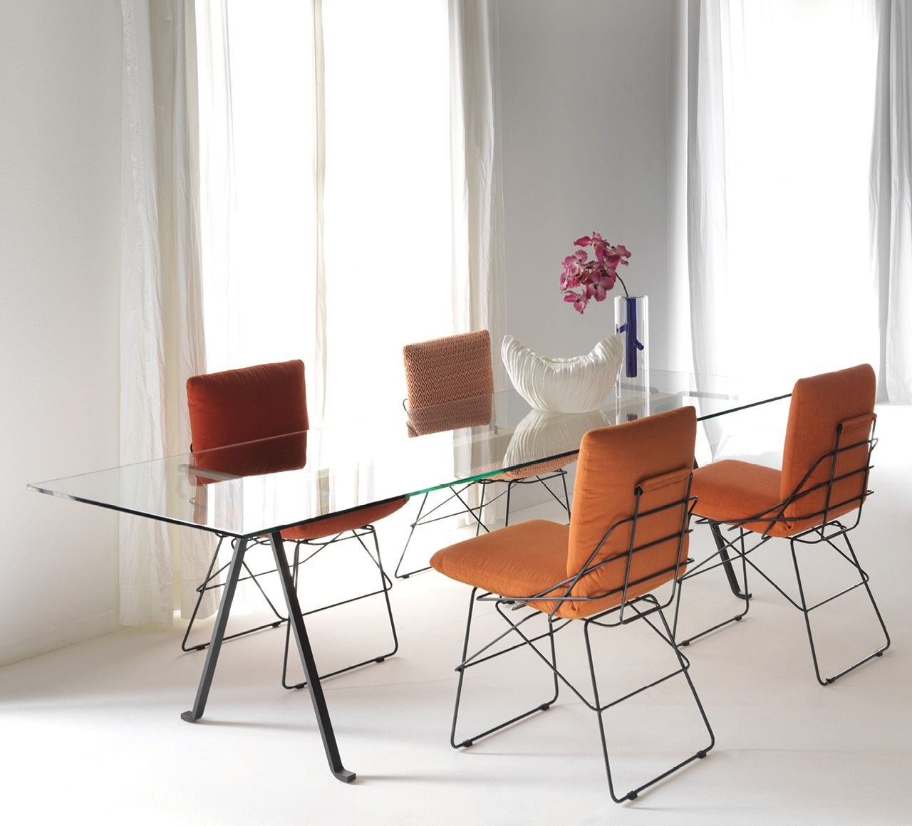 Sof Sof Chair - This chair has harmonious lines that convey the essential elegance of the design by Enzo Mari. Made by Driade in 1972, and redone in 2015, Sof Sof is a timeless icon. The structure is almost a sculpture, made up of nine steel rod rings that simultaneously define the top of the seat and the shape of the back  Indoor Use Only | Matter of Stuff