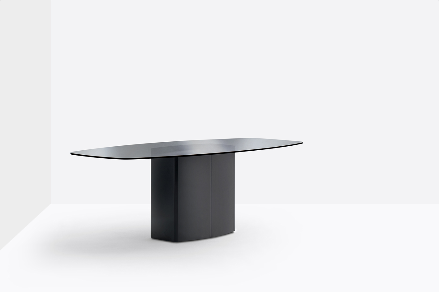 Aero Dining Table - Aero is a table with generous dimensions, simple in appearance but with a strong character. A steel cover split in two shells hides a central rectangular base with rounded corners combined with a refined glass or solid laminate top. It has a glossy black lacquered steel base, smoke grey tempered glass top thickness 12 mm, chamfered edge.</p>  | Matter of Stuff