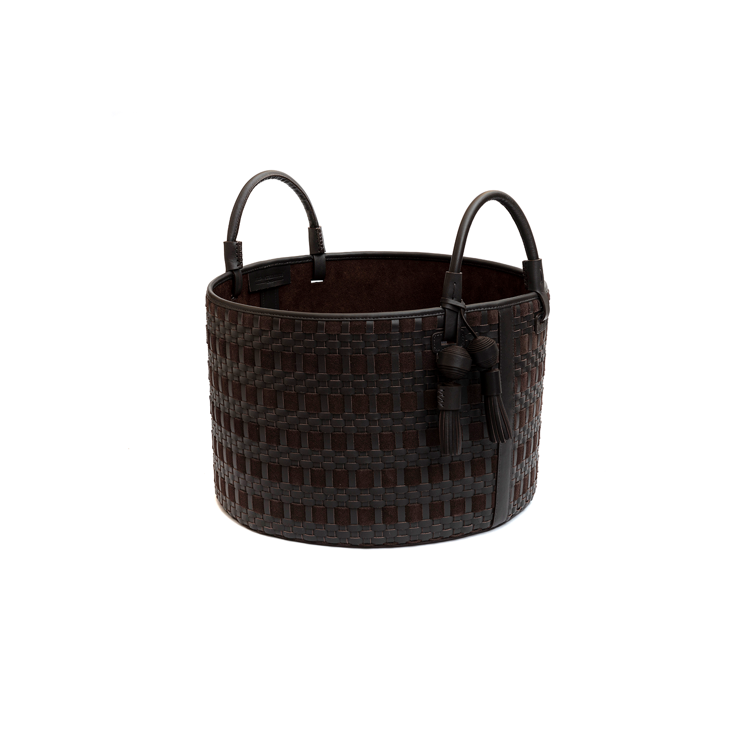 Paraty Tiras Woven Leather Basket - Paraty Tiras Woven Leather Basket is designed to complement an ambient with natural and sophisticated feeling, ideal when placed next your sofa or bed, perfect for magazines and throws storage. Elisa Atheniense woven leather pieces, are handmade and manufactured in Brazil using an exclusive treated leather that brings the soft feel and touch to every single piece. Elisa Atheniense Home Baskets have a delicate tassel attached.   The baskets are available in three sizes. Bespoke sizes are also available under project request as well as colours, see colour chart for reference. | Matter of Stuff