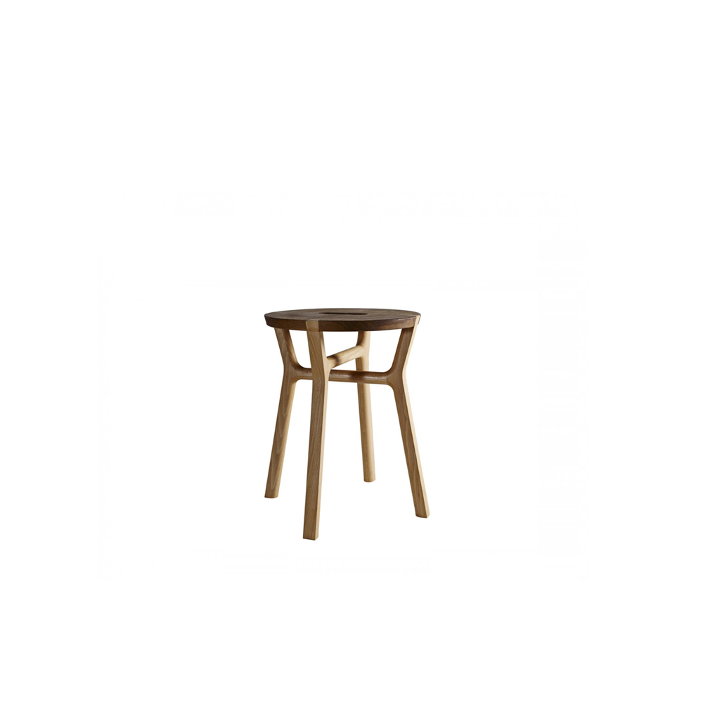 Affi Stool - A stool in solid wood, made by means of simple interlocks. The detail of the legs inserted in the seat is highlighted by the contrasting hues of beech and walnut. The overlapping crossbars convey a sense of skilled craftsmanship while providing exceptional stability.    Matter of Stuff