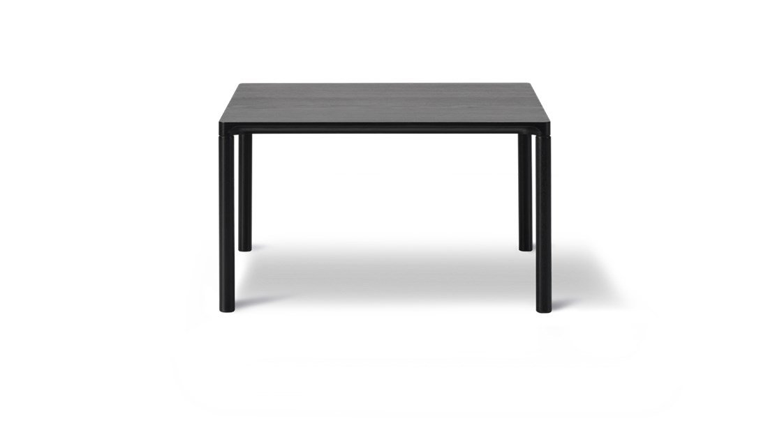"""Piloti 6725 Side Table - Piloti is a series of solid oak side tables. The subtle detailing of the table top creates the impression of a single line, floating between four delicate legs. The tables are supplied in two heights and can be combined as a nest.  The word """"piloti"""" refers to the pillars or columns that elevate a building above the ground. While the legs of our Piloti Tables resemble pillars, the overall intention is for the table to appear like a slim line almost floating in space.   An elegant integration of the table top with the legs ensures a subtle, streamlined transition into one balanced entity.   Light in appearance yet sturdy in construction, the Piloti tables in wood are made from solid oak, a naturally beautiful, tactile material that needs no adornment. The option of different sizes gives you the freedom to cluster the tables together in a corner or as part of a sofa set-up. Place them individually as side tables or as a matching pair on either side of a bed.   