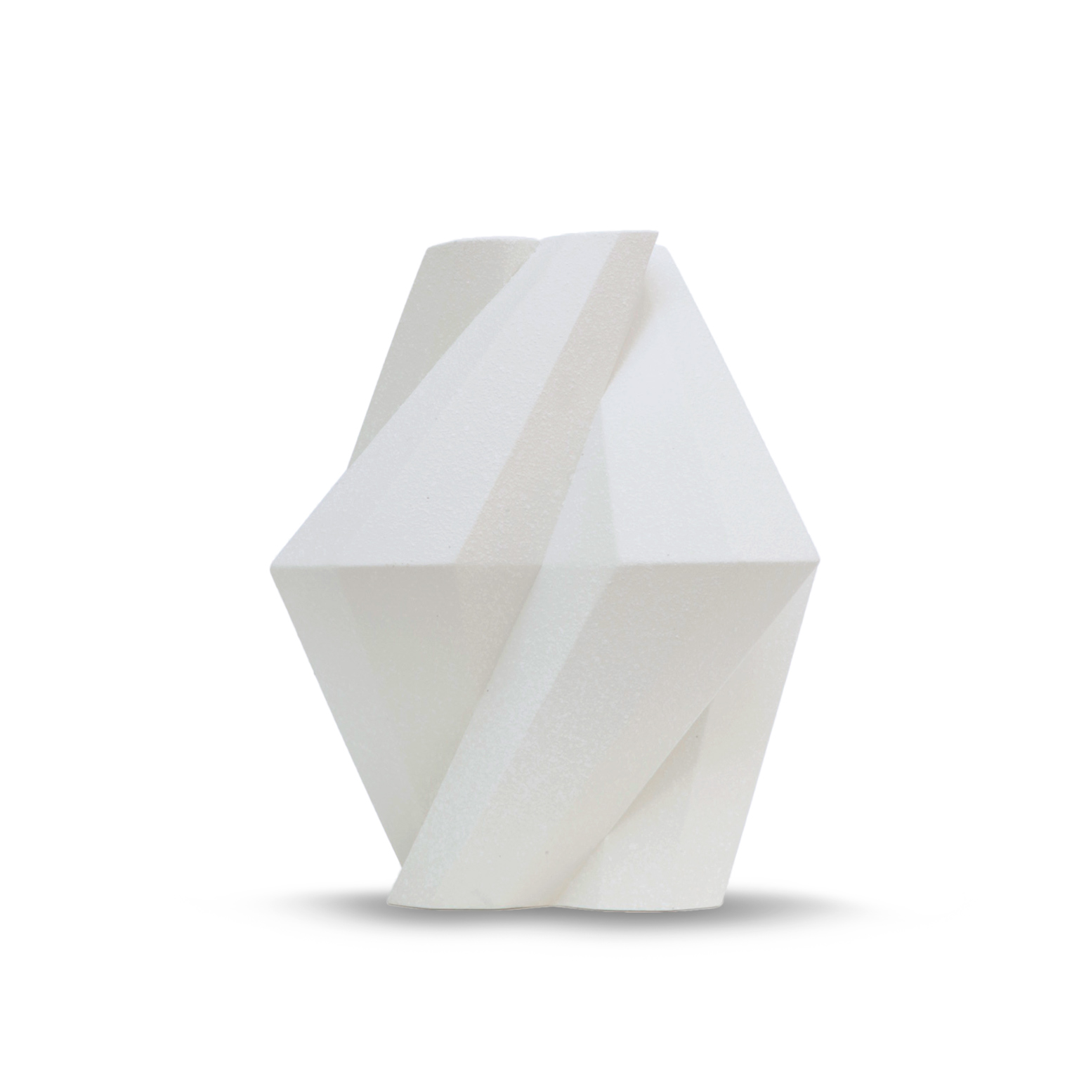 Fortress Pillar Vase White - <p>Designer Lara Bohinc explores the marriage of ancient and futuristic form in the new Fortress Vase range, which has created a more complex geometric and modern structure from the original inspiration of the octagonal towers at the Diocletian Palace in Croatia. The resulting hexagonal blocks interlock and embrace to allow the play of light and shade on the many surfaces and angles. There are four Fortress shapes: the larger Column and Castle (45cm height), the Pillar (30cm height) and the Tower vase (37cm height). These are hand made from ceramic in a small Italian artisanal workshop and come in three finishes: dark gold, bronze and speckled white.</p>    Matter of Stuff