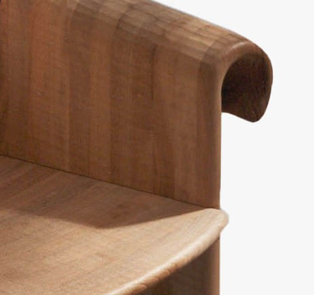 Velabro Armchair - <p>Velabro is a chair made from hand-carved planks. It is available in two versions: in Italian walnut with single-scroll back, or in maple with double scroll.<br />
