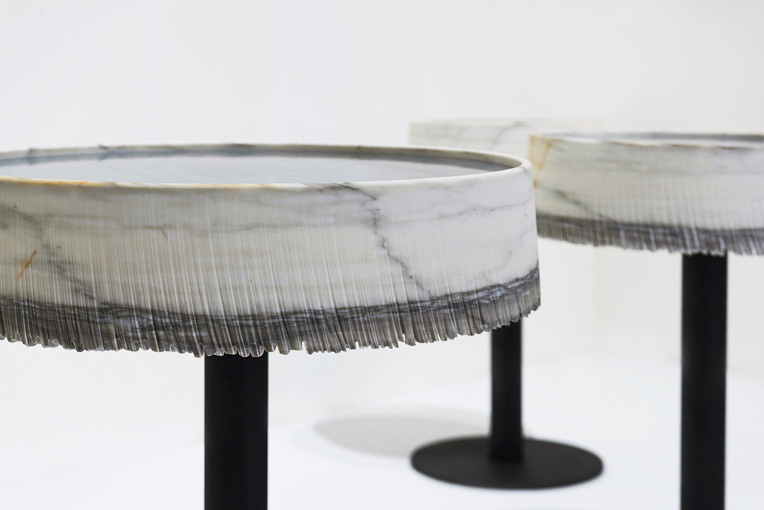 Drape Side Table - <p>*PLEASE ENQUIRE FOR PRICES AND BESPOKE DESIGN*</p> <p>DRAP is an emblematic work of art that enhances the peculiarities of natural stone with respect to synthetic materials. Those imperfections become aesthetic qualities thanks to remarkable technological research. </p> <p>A sort of drape that almost spontaneously takes the appearance of a tablecloth. It has a layered structure, with an ivory background, at times slightly rosy and is characterized by rich in quartz, pyrite and dolomite interfaces, from gray-green to light pink. The marble levels are amalgamated to form homogeneous bodies almost devoid from impurities and very similar to the Statuario type, called Cremo and Cremo Delicato.</p>  | Matter of Stuff