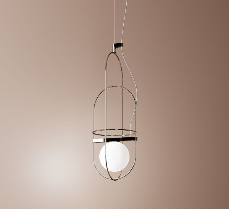 Setareh Suspension Lamp - This is the name of the family of lighting fixtures that Francesco Librizzi, a young Sicilian architect working in Milan, has designed for the first time for FontanaArte. Setareh was born of the idea of giving form to light. The lamp is composed of a sphere magically suspended within a thin metal structure. The play of circular masses and trajectories generates a balanced design of gravitational dynamics. The light from the sphere is diffused into the surrounding space, illuminating the frame. The reflections of the metal render the luminous field visible, space influenced by light, by its aura. The result is a collection of lighting elements, available in tabletop and suspension versions, of extraordinary poetic grace. Setareh takes on new dimensions: elongated, with either two or three spherical elements that work separately or together. Its vocation is the illumination of large spaces, with double-height ceilings or otherwise ample enough to accomodate expansive compositions of multiple elements. A firmament of Setareh, 'star' in the ancient Farsi language.  Suspension lamp with diffused and dimmable light 1-10 V / PUSH. Galvanized metal frame. Diffuser made of opalyne blown glass with satin-finish. Steel suspension cable. Black power cable. Painted metal ceiling rose. Integrated led.   Matter of Stuff