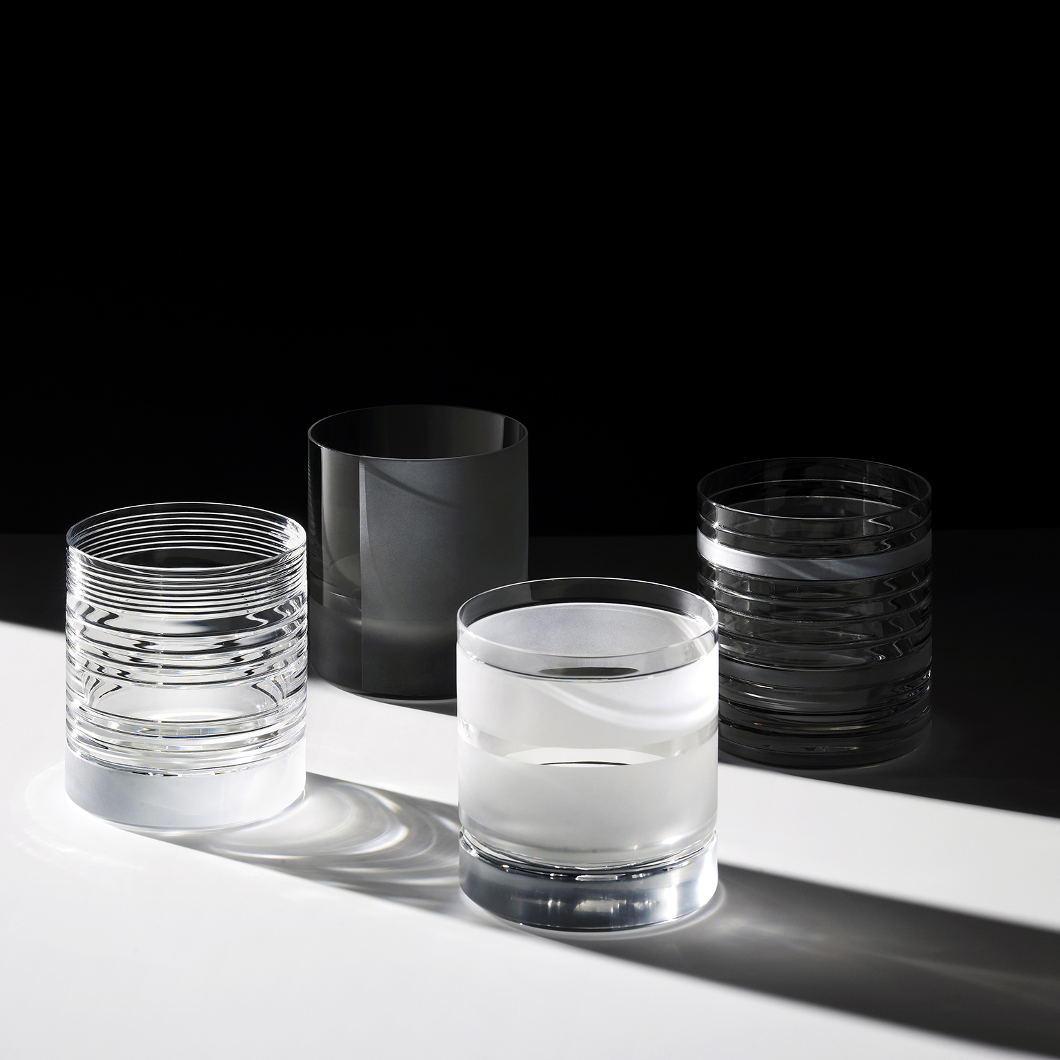 """Element Low Glasses - Set of 6 - A rich assemblage of graphic markings defines the """"ELEMENTS"""" series of lead crystal. Cuts and textures of varying depth and intensity are employed across glasses to create a landscape of layered pattern that is fresh and seductive; a whole new take on the decoration of cut crystal. Sold as a set of 6 low glasses.  