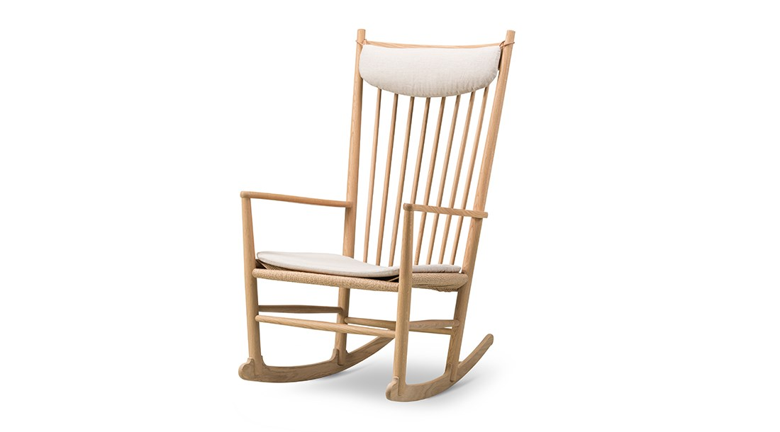 Wegner J16 Rocking Chair - Designed in 1944, Wegner 's rocker with the sensually curved arms was inspired by traditional Windsor and Shaker furniture, fused with Wegner's poetic lines.