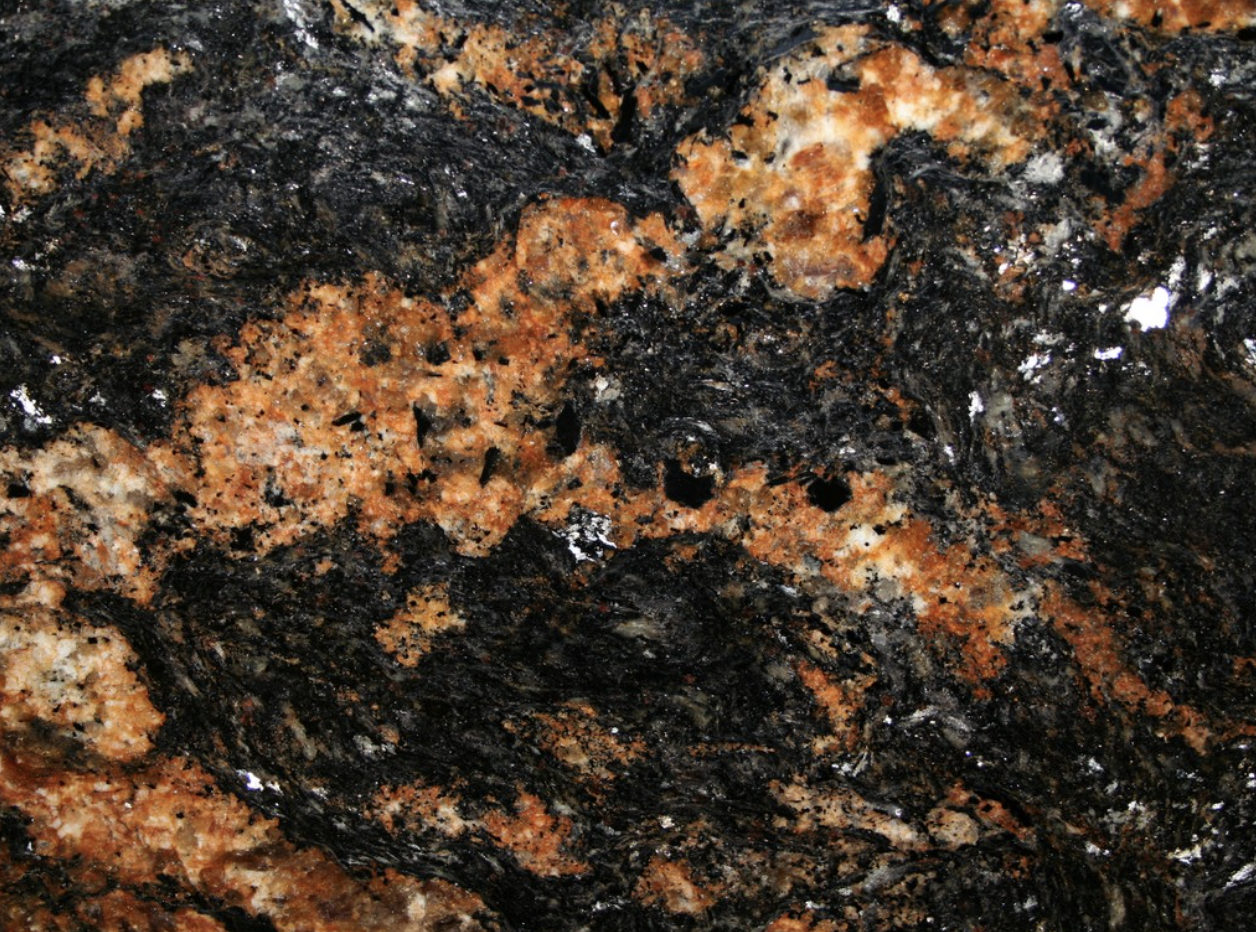 Black Fusion - Black Fusion is a very bright granite from Brazil. This stone is suitable for many designs but especially for kitchens, fountains and pools.   Matter of Stuff