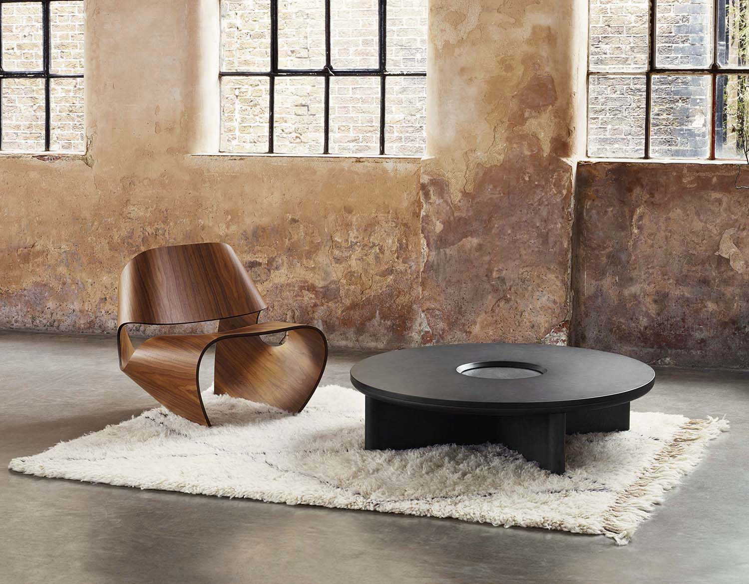Focus Table - <p>The Focus collection combines carved blackened oak with the organic richness of dark Welsh slate. The low-level circular coffee table features an aperture in the centre as a two-tier focal point while the deep grey slate acts as a window to frame the solid oak below.</p>  | Matter of Stuff