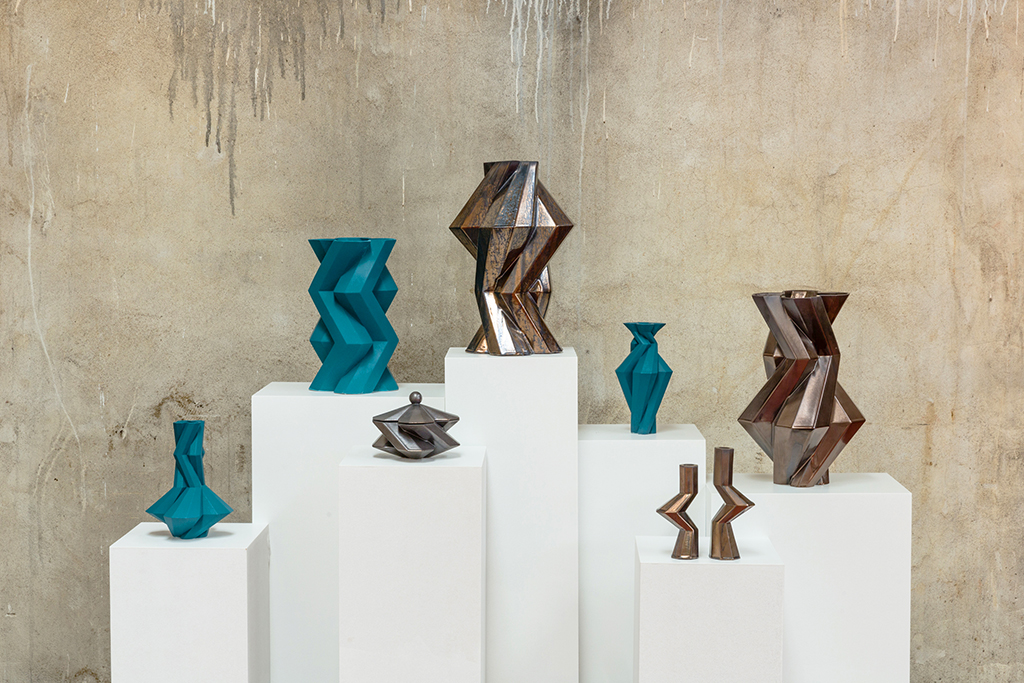 Fortress Spire Iron - <p>Designer Lara Bohinc explores the marriage of ancient and futuristic form in the new Fortress Vase range, which has created a more complex geometric and modern structure from the original inspiration of the octagonal towers at the Diocletian Palace in Croatia. The resulting hexagonal blocks interlock and embrace to allow the play of light and shade on the many surfaces and angles. There are four Fortress shapes: the larger Column and Castle (45cm height), the Pillar (30cm height) and the Tower vase (37cm height). These are hand made from ceramic in a small Italian artisanal workshop and come in three finishes: dark gold, bronze and speckled white.</p>  | Matter of Stuff