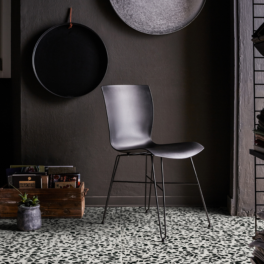 """Black Sesame Terrazzo Slabs - The name of the SEEDS collection, """"semi"""" in Italian, is intended to pay homage to the tradition of Seminato, an ancient Italian technique from which contemporary Terrazzo originated. As the word itself suggests, the technique consisted in spreading the marble fragments on the still fresh mortar. The gesture made in the act of sowing has an ancestral meaning in itself: we owe our evolution to nature, which has taught us this.  The poetic image of the traveling seed, at the mercy of the wind and the sea, landing on beaches in unknown lands ready to germinate to give birth to a new plant, is the great metaphor that MIPA wants to use to communicate the urgency and the need to imagine a future made of care, recovery of emotions and enhancement of simple gestures.  SEEDS is a call to the origins.  The colour that distinguishes the entire collection is that of sand. A single background colour, warm, on which the marble fragments rest in the eight colours that make up the palette with a sophisticated aesthetic result.  The new SEEDS collection was born thanks to the collaboration with Laura Renna, a visual artist MIPA has a longstanding relationship with, hosting her studio inside the company. In her artistic research, Laura is used to face themes such as tradition, nature and space.  The materials in the collection are available in different standard sizes. Bespoke sizes are also available to meet the specific requirements of your projects. 