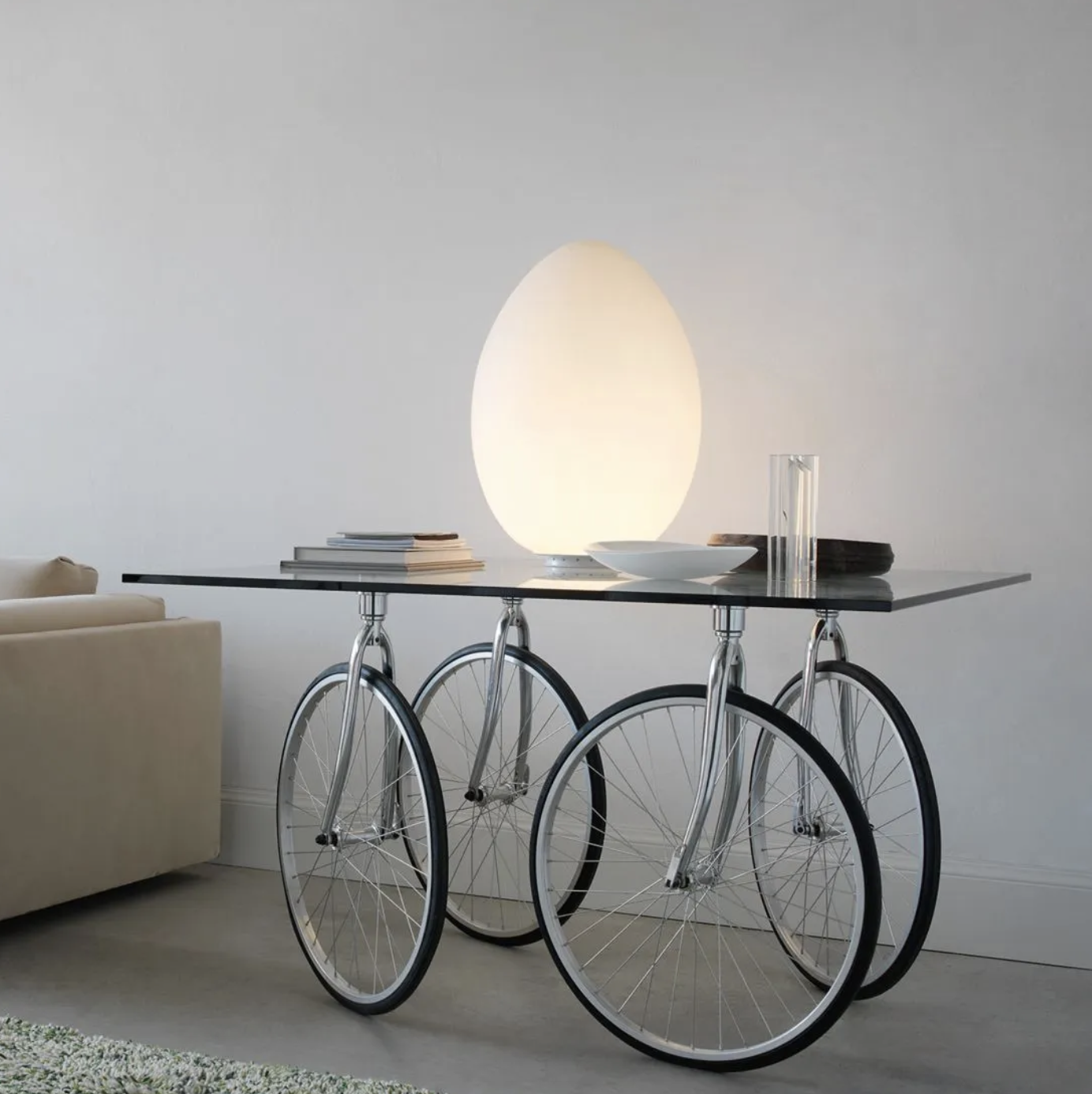 Tour Table - Tour is the evolution of the Table with Wheels. Again with wheels, but in this case taken from bicycles, it was a surprising piece.   Table with ground float-glass top. Rotating wheels fixed to the top by four stainless steel plates. Chromium-plated brackets. All-rubber wheels.   Matter of Stuff