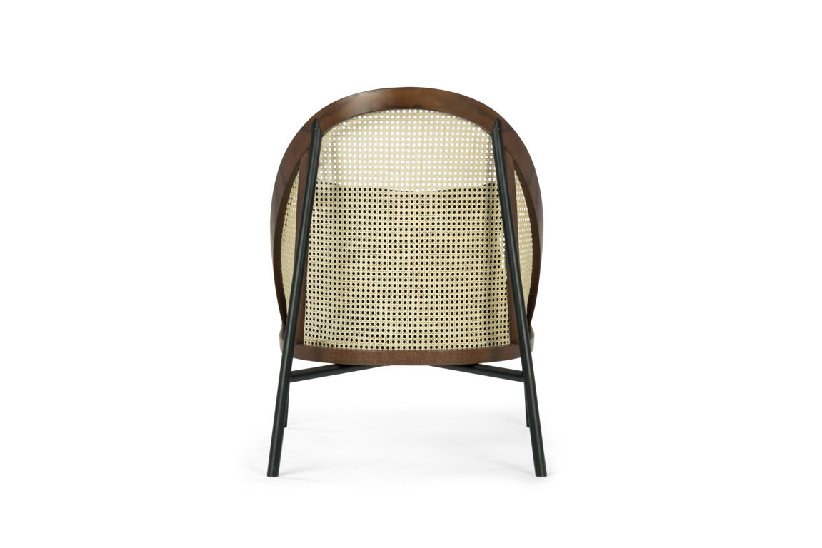 Loïe Lounge Chair - <p>A harmonious combination of comfort and refined design, tradition and modern aesthetic. The standout element of this piece is its enveloping Viennese straw back and sides, framed in an elliptical structure in walnut-stained beechwood that was bent with Viennese-style signature steaming method. The base is in metal with a powder-base black finish with fabric belts to support the cushions. The wood is also available with a black stain.</p> <p>&nbsp;</p>  | Matter of Stuff