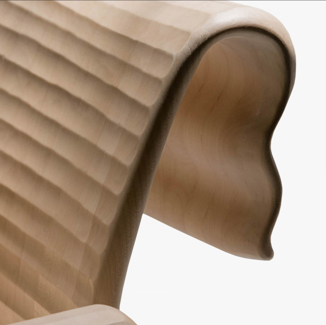 """Velabro Armchair Double - <p>Velabro is a chair made from hand-carved planks. It is available in two versions: in Italian walnut with single-scroll back, or in maple with double scroll.<br /> It is finished manually on all sides by gouging. The entire manufacturing and finishing process is carried out manually in our workshop. Juglans Regia – common Italian walnut – not dried but """"raw"""", belongs to the Latin tradition of furniture-making. It features an extremely compact fibre which can, however, be worked without too much difficulty; it is therefore highly suitable for household items. Maple is a wood from the temperate European zone traditionally used for musical instruments; it has a subtle, fine grain, very distinctive, and characteristic white colour. The exquisite curve of the back and arms and the precise rounding of all edges make this armchair a comfortable item of great beauty. Customise and made with Slavonian oak, European cherry.</p>  