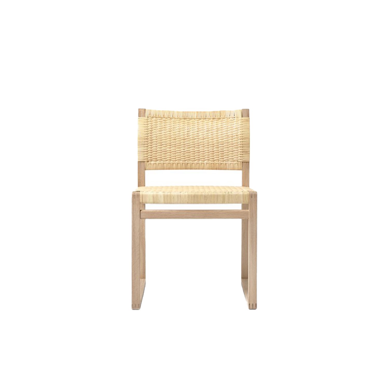BM61 Chair Cane Wicker - Børge Mogensen brings us back to nature with the choice of cane wicker or linen webbing coupled with a solid wood frame. In a slender design involving only what's crucial to the construction. By carefully calibrating the angle of the back rest, it's a simple yet striking dining chair that's comfortable before, during and after dinner.  Two versions in two different natural materials attest to Børge Mogensen's talent for pared-down shapes elegantly engineered for comfort. Dispensing with anything extraneous in favour of clean lines in a pure, iconic design that defies any temporary trend.   Both the BM61 Chair and the BM62 Armchair exude a certain authenticity. Designed with an exposed construction that reveals immaculate joinery and hand craftsmanship. Along with the choice of honest materials, such as natural cane wicker or linen webbing in natural or black for the seat and back together with a solid wood frame. It all reflects our expertise in materiality since our inception.   One glance at the chair in profile and you'll notice a slight angle to the rear post, which changes to provide optimal support for the back. With the lower section supporting the small of the back in an upright position, and the upper part providing support in a more relaxed position. What's more, the sledges not only ensure continuity, they're the perfect choice for soft floors.   As a dining chair, the BM61 Chair and BM62 Armchair are a comfortable seating solution for before, during and after dinner. Ideal for top-star restaurants, hotels and private homes. Choose the side chair or armchair, and you have a statement piece that is suited for galleries, museums and cultural centres. Luxury retail and residential settings, executive environments and more.  | Matter of Stuff