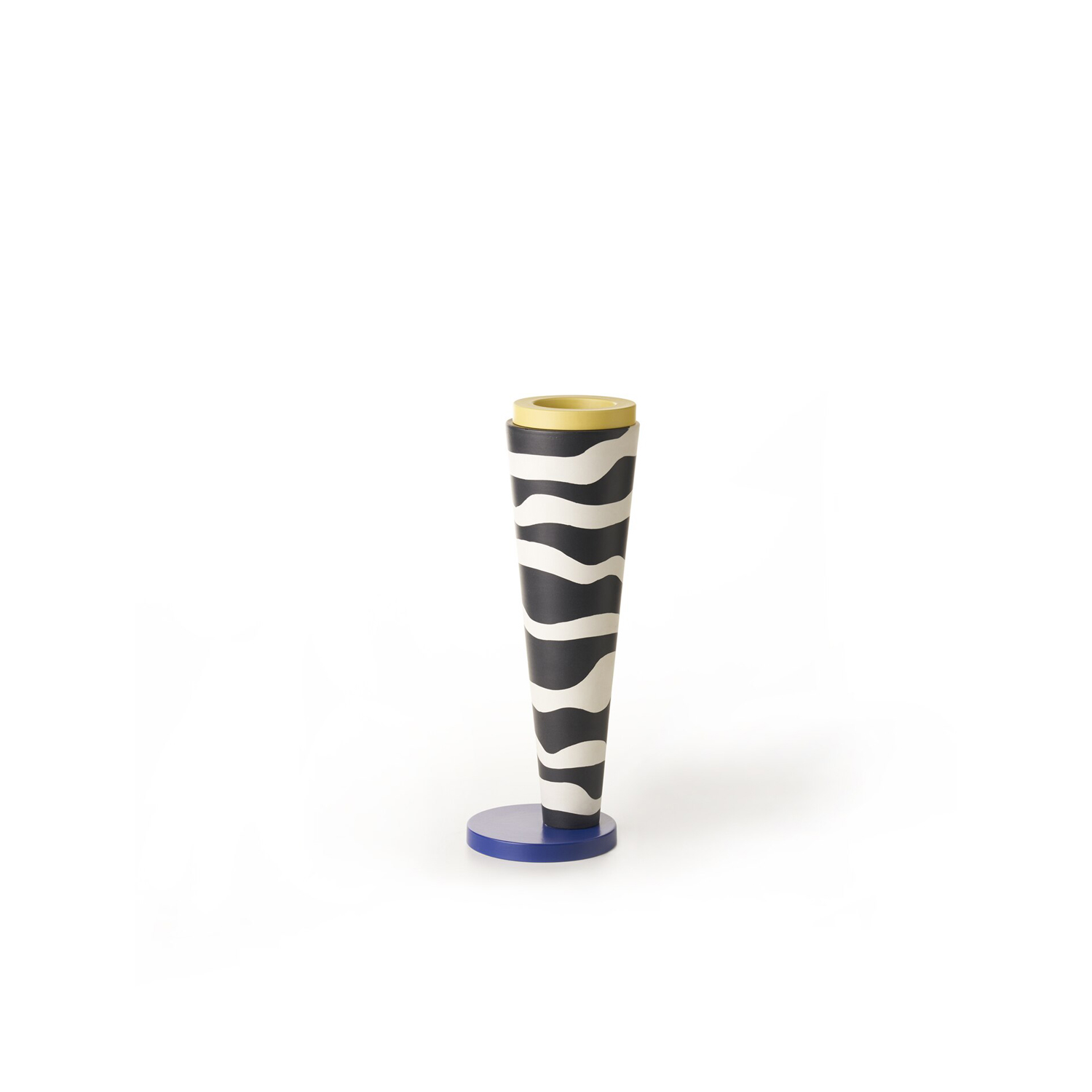 GJS Vase B - This striking vase hand-turned in white clay features a matt black pattern on white glaze. The base and mouth of the piece are covered in blue and yellow glaze.