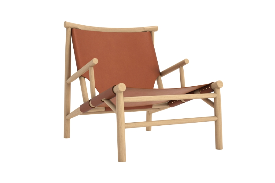 Samurai Lounge Armchair - Samurai is a modern lounge chair, made from turned oak timber sections with the seat and back in high quality saddle leather or canvas. Whilst studying hunting chairs of the mid-20th century, designers Kristian Sofus Hansen & Tommy Hyldahl have created a modern interpretation of the low-slung hunting chair type, with construction inspired by Japanese simplicity combined with the Danish stick chairs of the 1950's.  Samurai is offered with saddle leather from Sorensen Leathers or premium quality re-enforced canvas, which folds around the chair like armour and carries the body with ease. The seat is mounted with brass rivets in order to achieve maximum strength, whilst the back is mounted with adjustable leather straps and brass buckles. Both the leather and canvas is handmade in Denmark in proud Danish furniture tradition. | Matter of Stuff