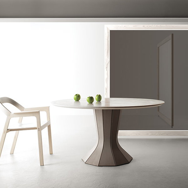 """Opera Fisso Dining Table - Extensible Table in aluminium.   Strong visual impact and contemporary taste, extensible """"Opera"""" doesn't just stand out for its statuesque aspect and its stately fascination, but also for the remarkable technical features that it internally hides. By opening, indeed, it reveals a central leg which gives extreme stability to the structure and a large surface. 
