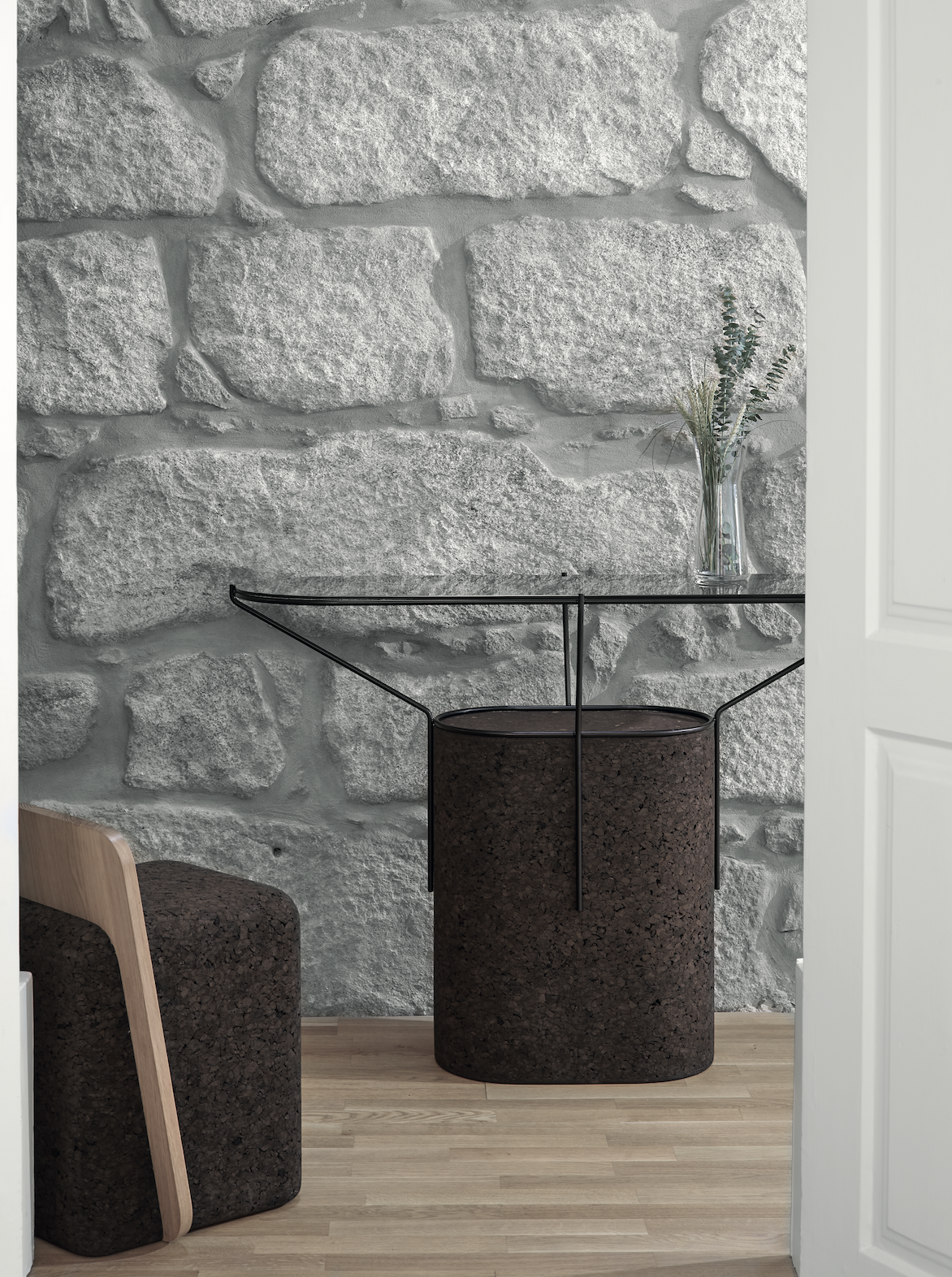 """Cut Side Table - It is only used cork of the branches (falca) for the manufacture of cork granules. These are block clusters in autoclave, being 100% natural process, without use of additives. Technology, developed by Sofalca, consists of injecting water vapour through the pallets that will expand and agglutinate with the resins of the cork itself. This """"cooking"""" gives also dark colour to the agglomerated cork, like chocolate. In the production of steam I used biomass, obtained on milling and cleaning the falca, what makes it truly ecological production and without waste, 95% energy self-sufficient. As a super-material, cork offers so many advantages, because in addition to its excellent thermic, acoustic insulation and anti vibration characteristic, it is also a CO2 sink playing a key-role in the environment.   Matter of Stuff"""