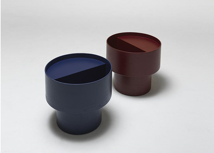 Vinnie Side Table - <p>The Vinnie side table stems from the desire to create a space in which to place and conceal all the objects that orbit around a sofa (magazines, books, remote controls,etc.). </p> <p>The result is a circular top, cut in half, with a higher portion and a deeper recess for storage. The table is made with the same technique utilized for the cylinders of drums, with a continuous, seamless piece of plywood. Hence the name, a tribute to Vinnie Colaiuta, an American with Italian origin considered by many to be the world's greatest living drummer.</p> <p>Vinnie side table is available in red and blue.</p>  | Matter of Stuff