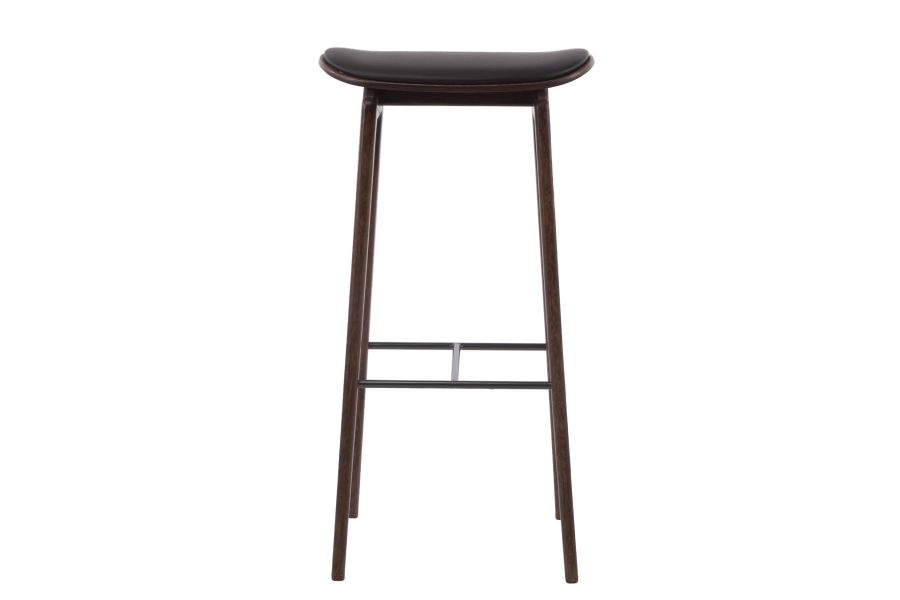 NY11 Bar Stool Upholstered - The NY11 Bar Chair has a frame hand-crafted from solid white oak and a seat of laminated oak veneer. The leather edition can be upholstered with premium leather or vintage leather from Sørensen Leather.The NY11 series is inspired by traditional Danish school chairs designed throughout the twentieth century. The NY11 Bar Chair comes in two heights, 65 cm and 75 cm, making it perfect for kitchen islands in private homes or as a stylish bar chair for public spaces.
