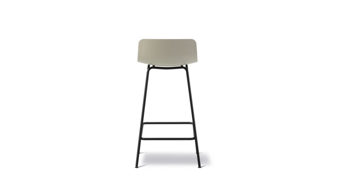 Pato 4 Leg Stool Seat Upholstered - Pato is a carefully crafted multipurpose chair in eco-friendly polypropylene that can be used outdoors. The chair is available with a range of optional features including coupling. The chair can be tuned from basic to exclusive with optional upholstery.  Pato is a prime example of our focus on sustainability and protecting the environment, reflected in a chair that's 100% renewable and recyclable. All components can be incorporated into future furniture production, thus contributing to a circular economy by minimising the use of materials, resources, waste and pollution.   Merging traditional production methods with cutting-edge technology, Pato is a human-centric, highly versatile series of multi-purpose functional furniture that draws on our in-depth experience with materials, immaculate detailing and heritage of fine craftsmanship. Allowing us to apply our high standards of texture, finish and carpentry techniques to an array of materials in addition to wood for products aimed at a mass market.   With its clean lines and curves, Pato echoes the ethos of Danish-Icelandic design duo Welling/Ludvik. Demonstrating their belief that good design has the ability to be interesting, even when reduced to its most simple form. Where anything extraneous is eliminated and every detail has a purpose.   Together we spent nearly three years developing the shell structure to have a soft surface that's also wear and tear resistant. Enhancing the chair's ability to optimally conform to the user's body is a subtle beveled edge. A technique from classic cabinetmaking, which gives the chair a sense of handcrafted finesse. Each Pato is detailed and finished by hand by our highly skilled crafts people, who refine the beveled edge and the silky, resilient surface. Setting a new standard for the execution and finish of polypropylene.   Since the success of its initial launch, we've expanded Pato into an extensive collection of variants, featuring armcha