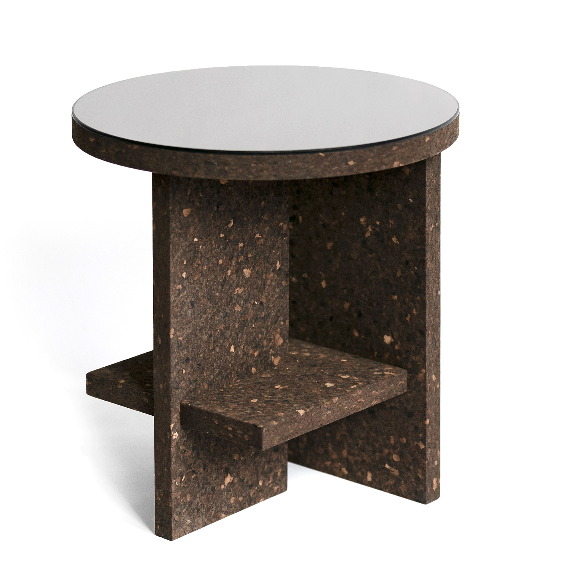 Cruz del Sur Side Table Dark Cork - <p>Compact and light, flat-pack side table in Portuguese cork. This special edition designed for Disegno Magazine Cruz del Sur table snaps on together in just seconds without the need of tools, it's made in London using sustainable cork from Portugal and comes in a flat-pack. This mighty but compact table features a shelf for reading books and accessories to keep your tabletop clutter-free. Available in light or dark cork finished in natural oil-wax with the option to add-on a bronze finish mirror top. </p>