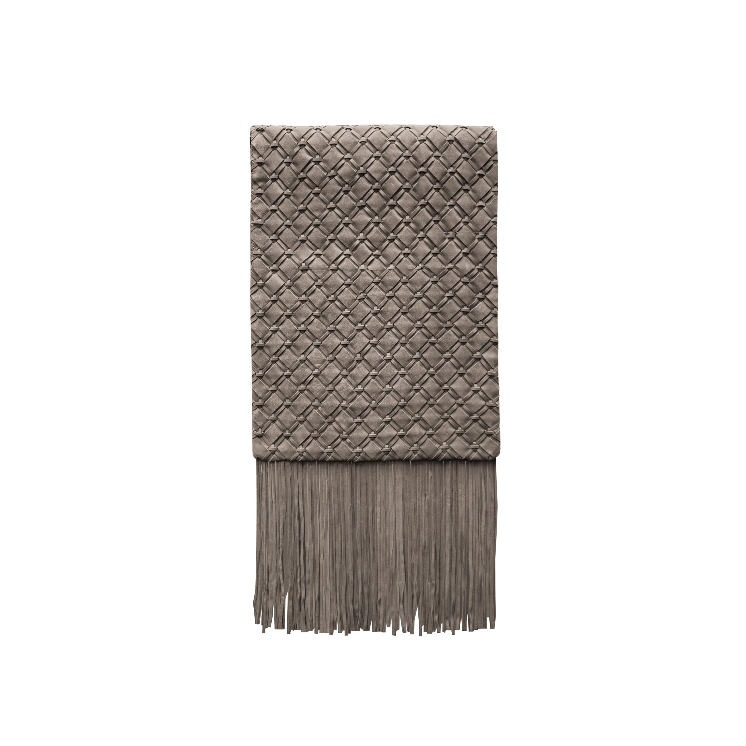 Geometrico Woven Leather Throw - The Geometrico Woven Leather Throw is designed to complement an ambient setting with natural and sophisticated feeling. Our woven leather pieces, are handmade and manufactured in Brazil using an exclusive treated leather that brings the soft feel touch to every single piece. 